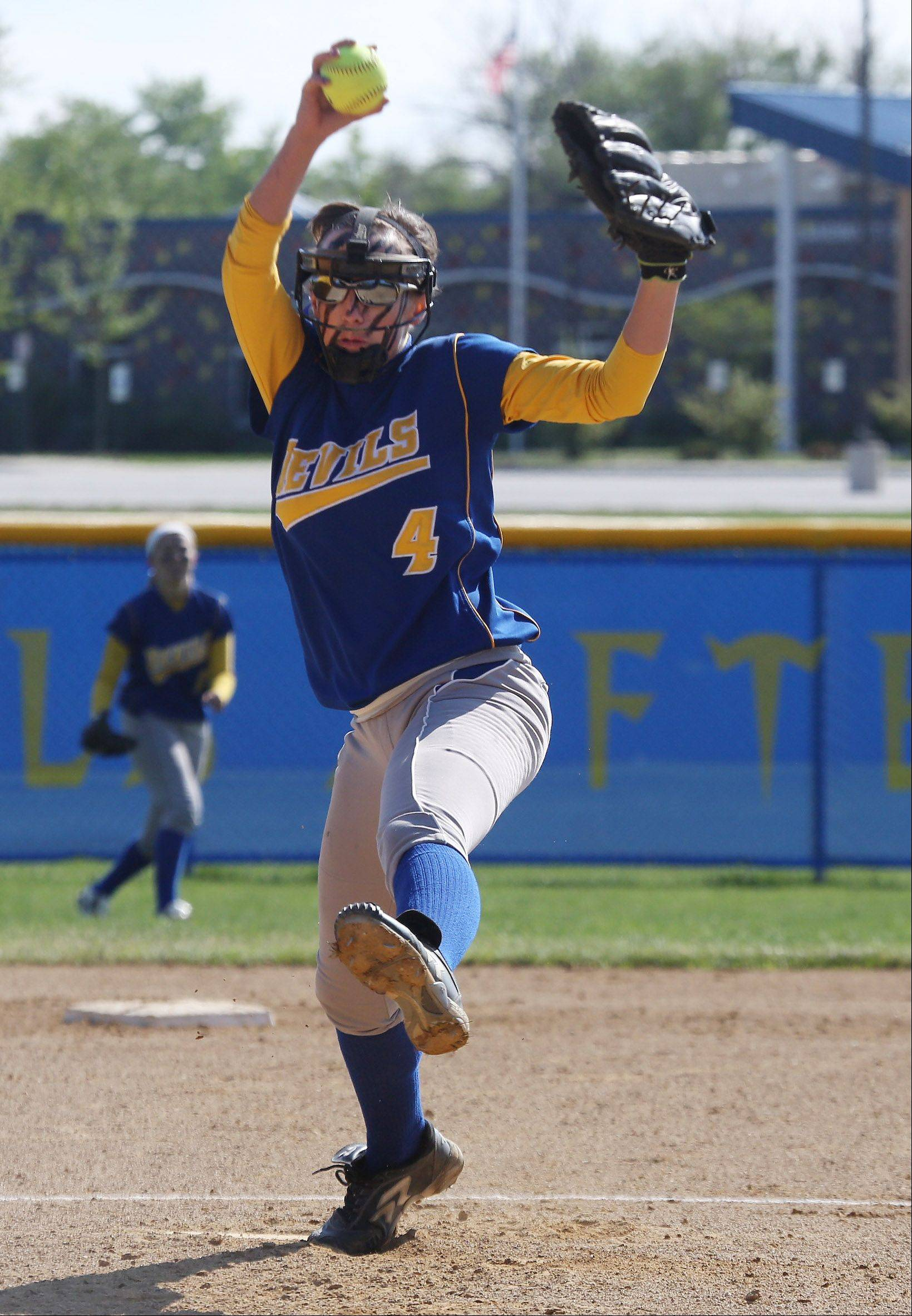 Warren pitcher Jana Wagner makes a throw during Class 4A regional semifinal play Thursday at Warren.