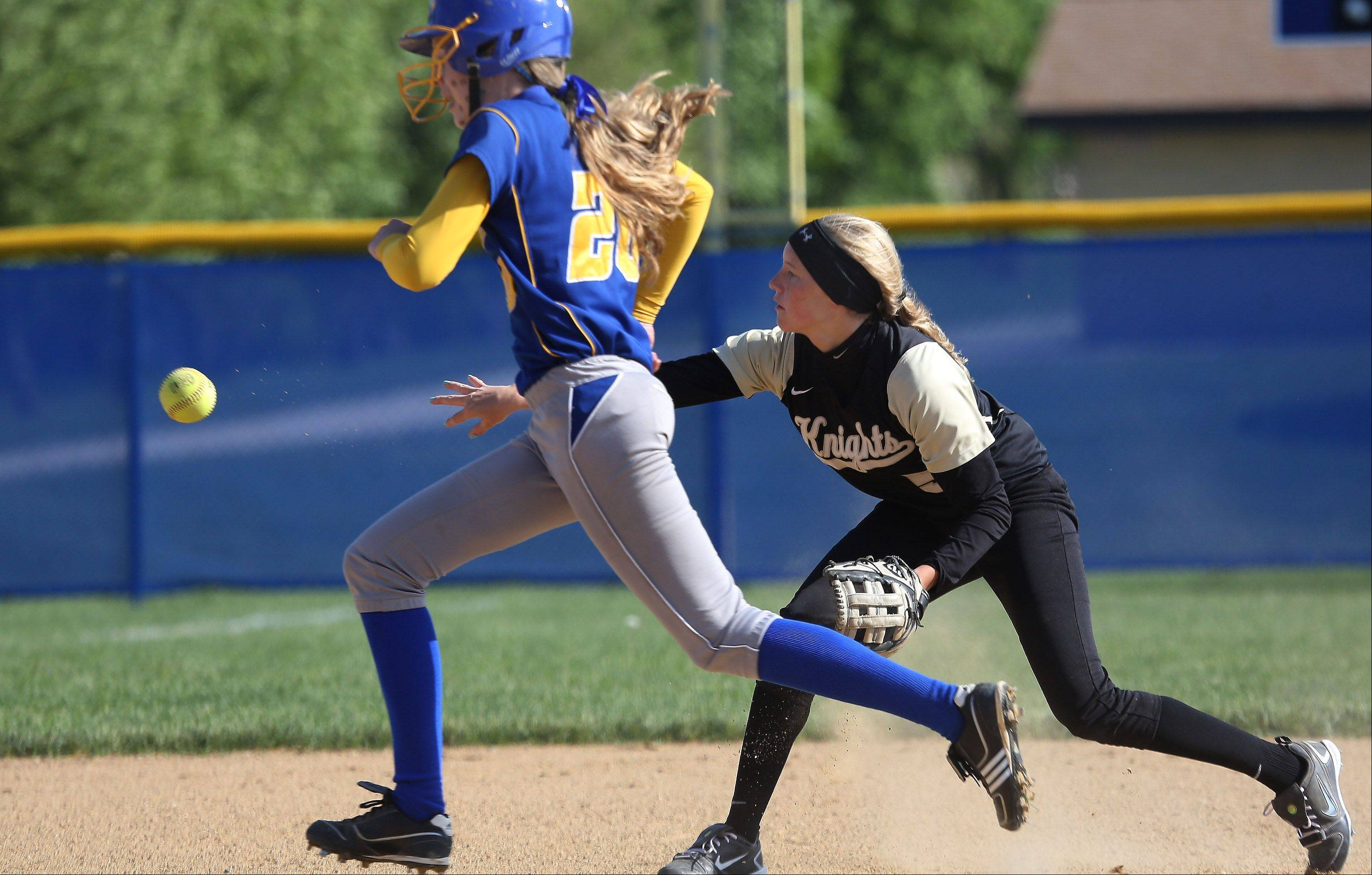 Grayslake North shortstop Jordyn Bowen throws to third base, forcing an out on Warren runner Shannon McKeon during Class 4A regional semifinal play Thursday at Warren.