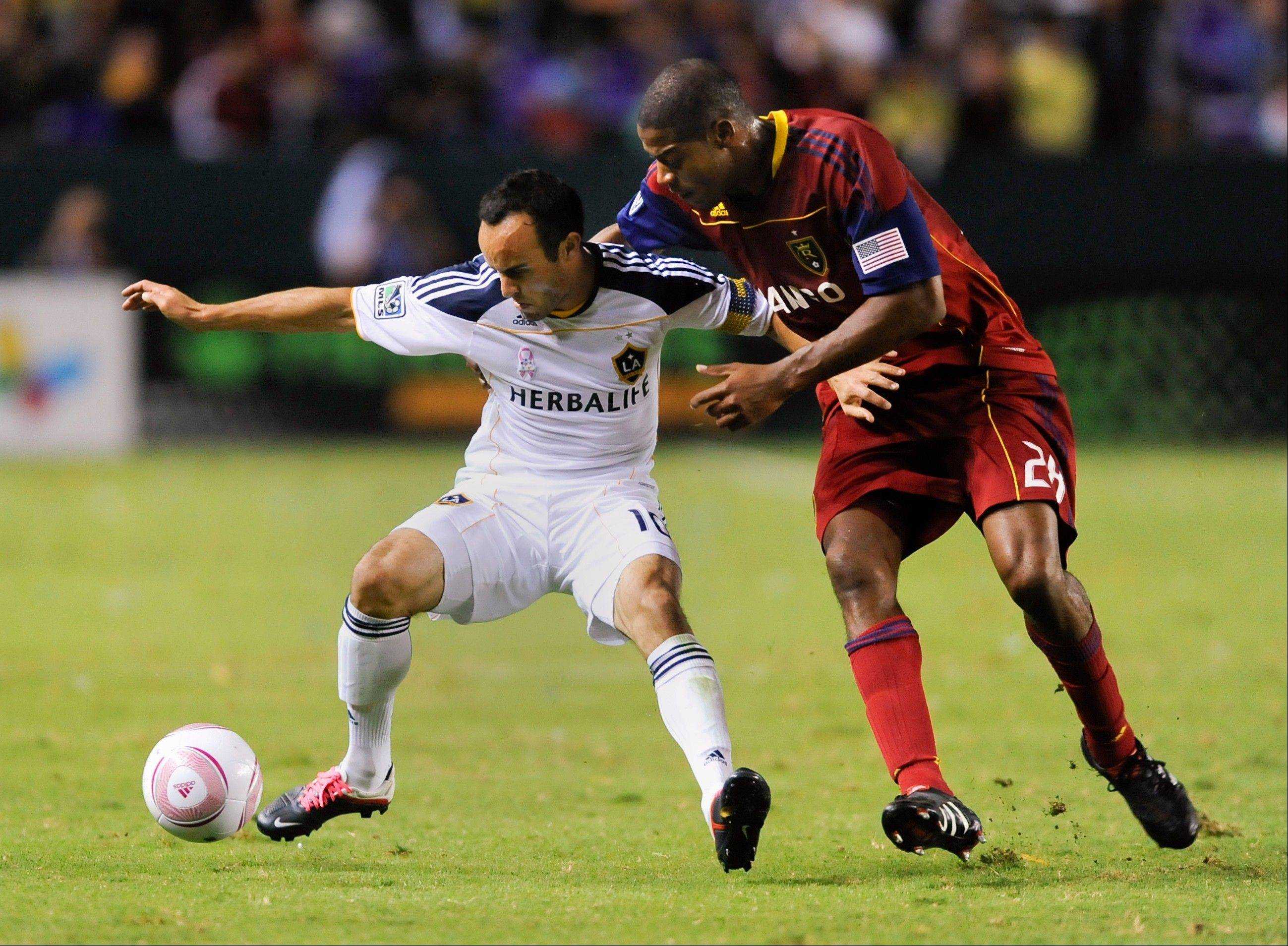 Real Salt Lake defender Chris Schuler, at right trying to control the Galaxy's Landon Donovan, has helped anchor the back line for RSL this season.