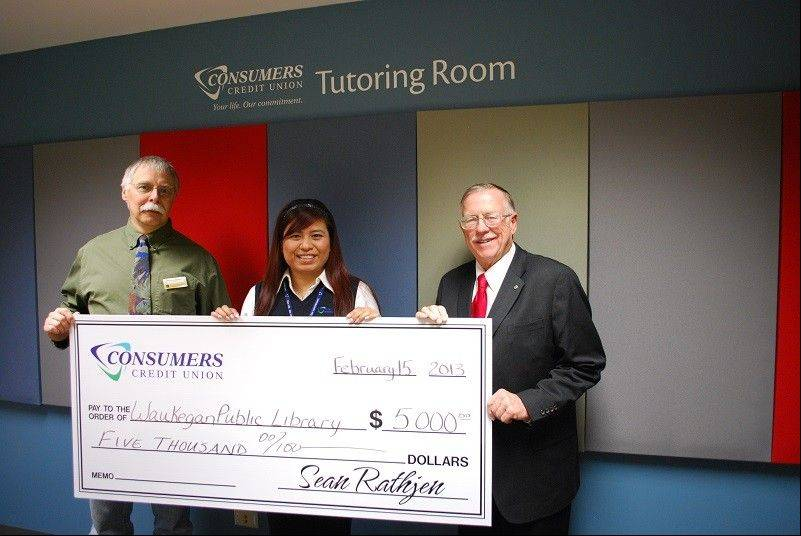 From left, Waukegan Public Library Director Richard Lee receives a check for $5,000 from Maria Contreras, CCU's corporate development and marketing coordinator, and Dr. John Schwab, CCU board of directors and treasurer of the city of Waukegan.