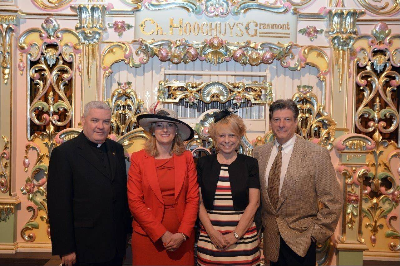 "Pictured, from left, at ""The Derby Whodunit,"" on May 4, are: Monsignor Michael Boland, president of Catholic Charities of the Archdiocese of Chicago; Sandra Adamczyk, Hearts event chairwoman; Mary Insprucker, Catholic Charities Northwest Regional director; and Garry Meier, WGN personality."
