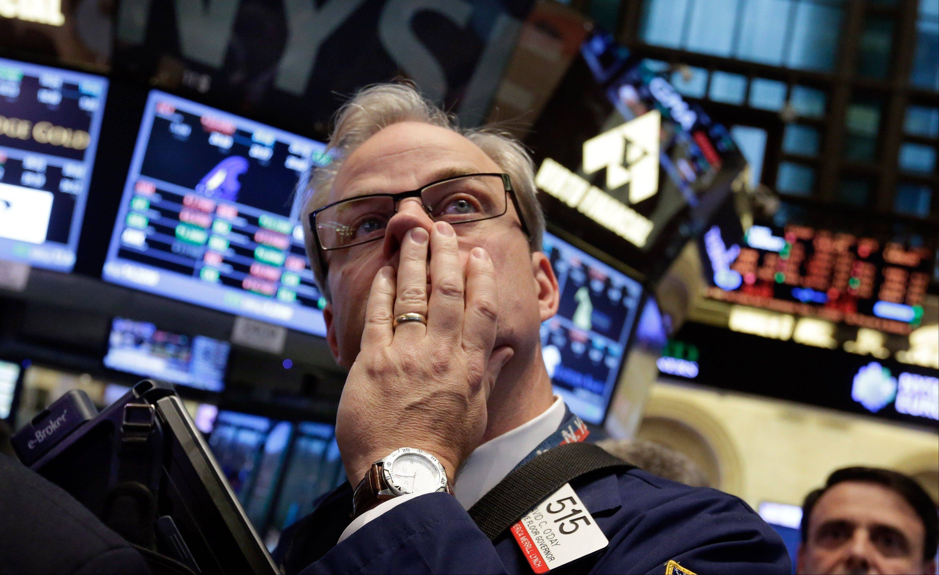 Trader David O'Day works on the floor of the New York Stock Exchange Thursday at the close of trading.