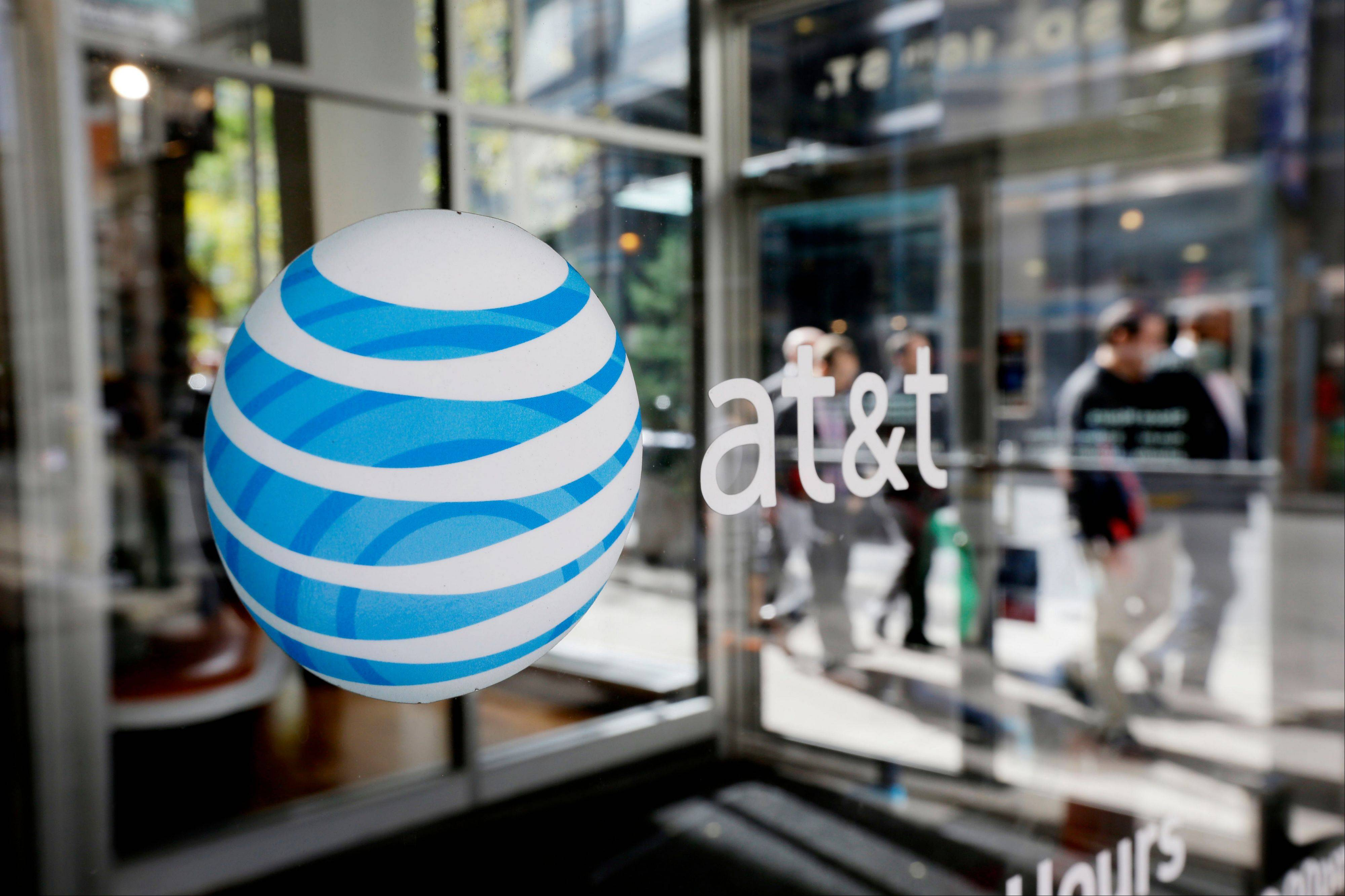 The AT&T logo is displayed on an AT&T Wireless retail store front. AT&T said it has completed its LTE 4G rollout in many Northwest suburbs.