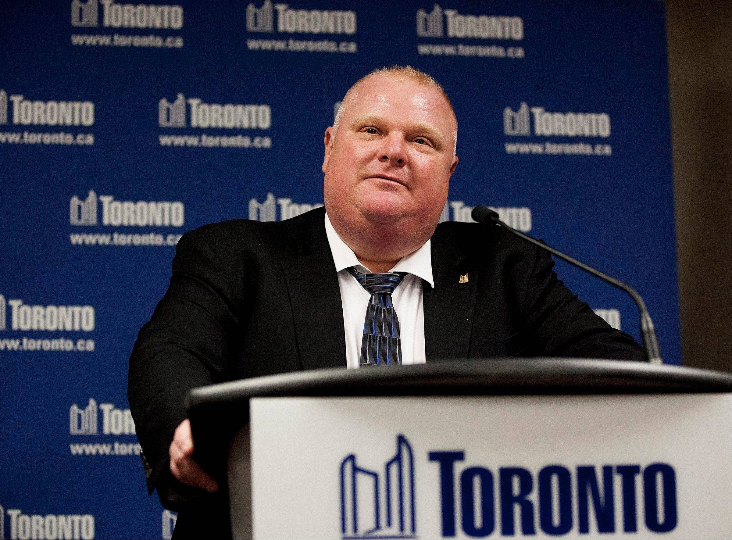 Toronto Mayor Rob Ford denies allegations that he smokes crack cocaine as he speaks Friday to the media at Toronto City Hall.
