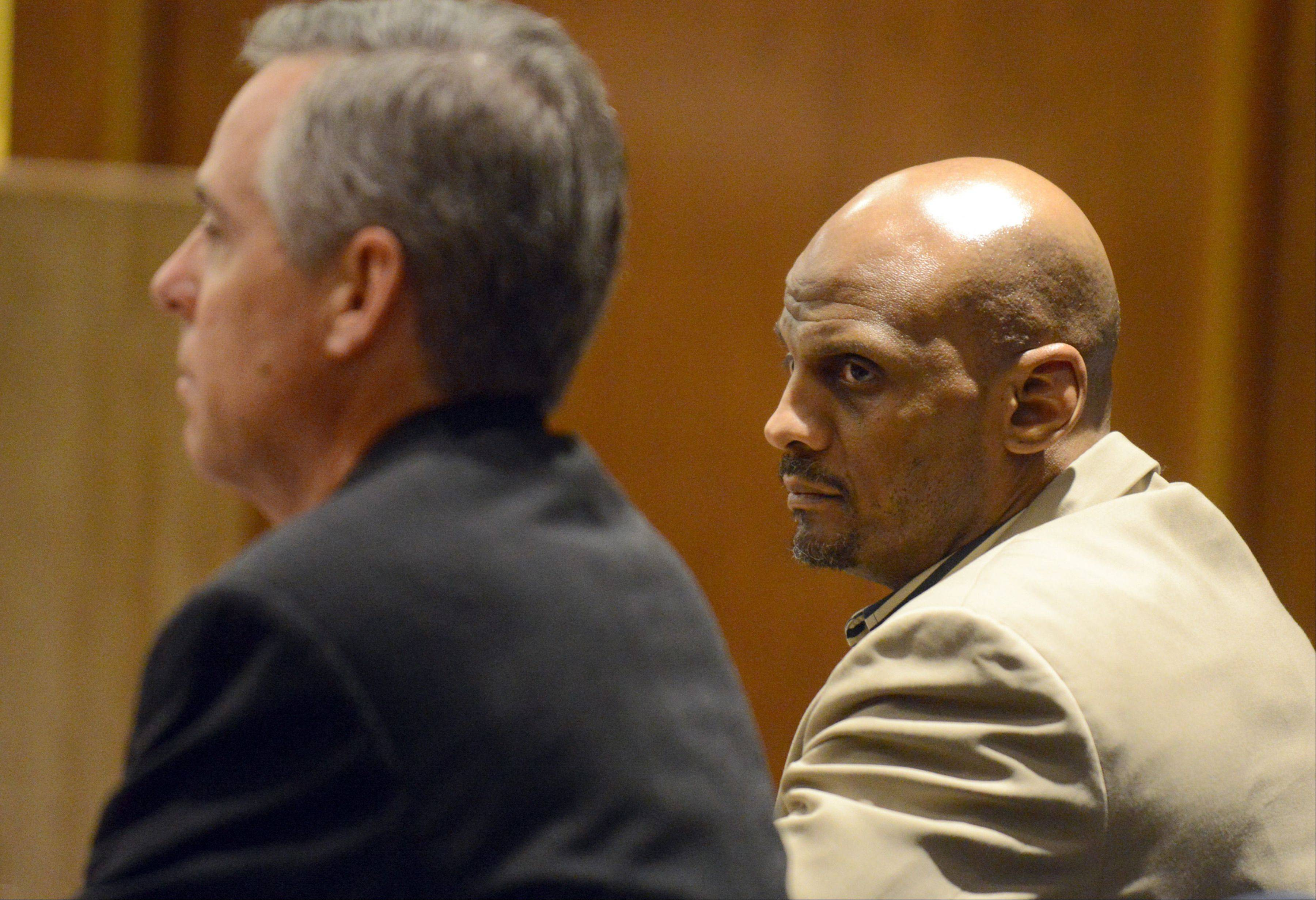 James Ealy 48, of Lake Villa sits next to his attorney, public defender Keith Grant, as the verdict is read and he is found guilty of first-degree murder in the strangulation of Mary Hutchison of Trevor, Wis., during a robbery at the Burger King in Lindenhurst on Nov. 27, 2006.