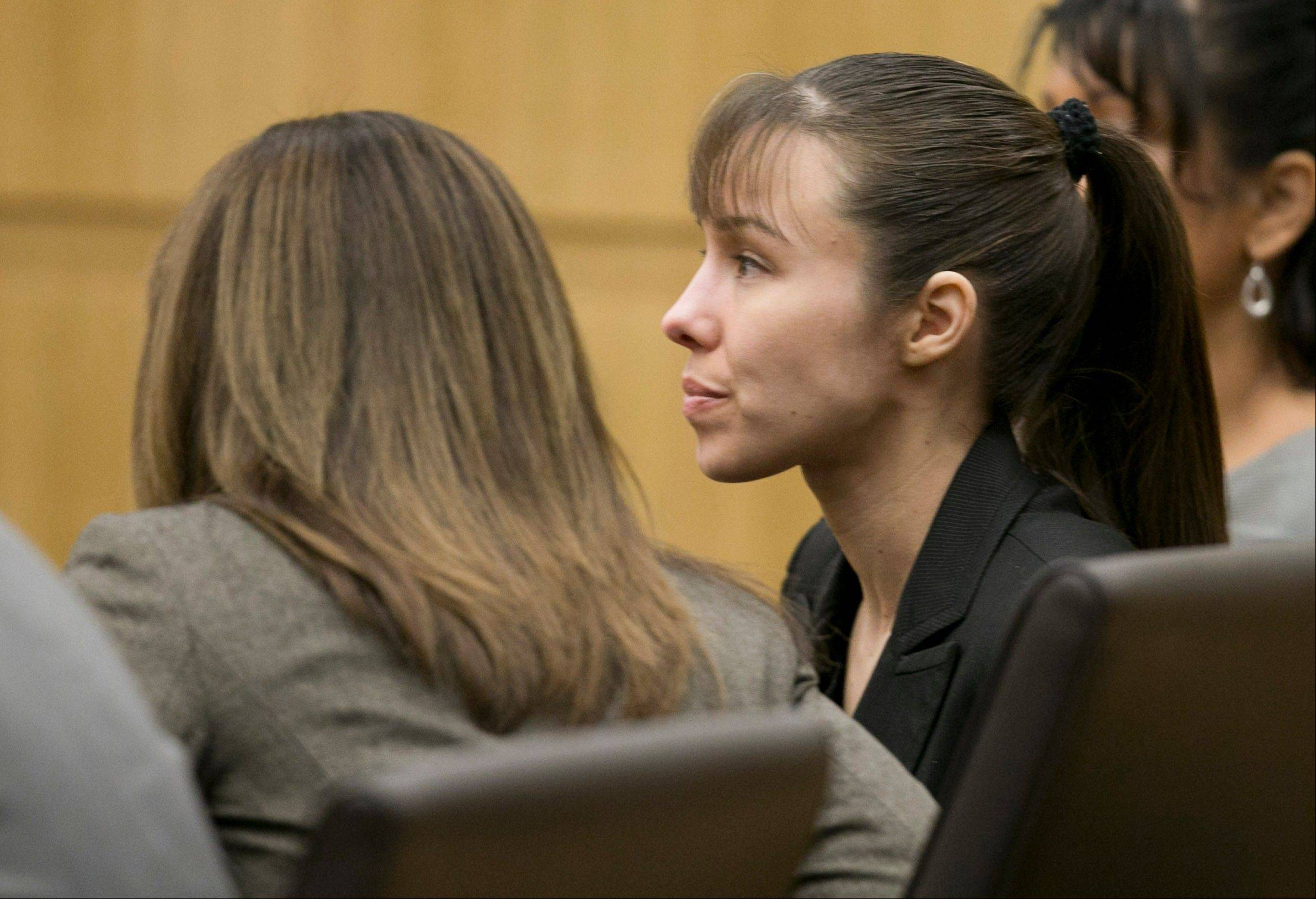 Jodi Arias listens as the verdict for sentencing is read for her first degree murder conviction at Maricopa County Superior Court in Phoenix, Ariz., on Thursday, May 23, 2013. The jury in Jodi Arias' trial was dismissed Thursday after failing to reach a unanimous decision on whether the woman they convicted of murdering her one-time boyfriend should be sentenced to life or death in a case that has captured headlines worldwide with its sex, lies, violence.