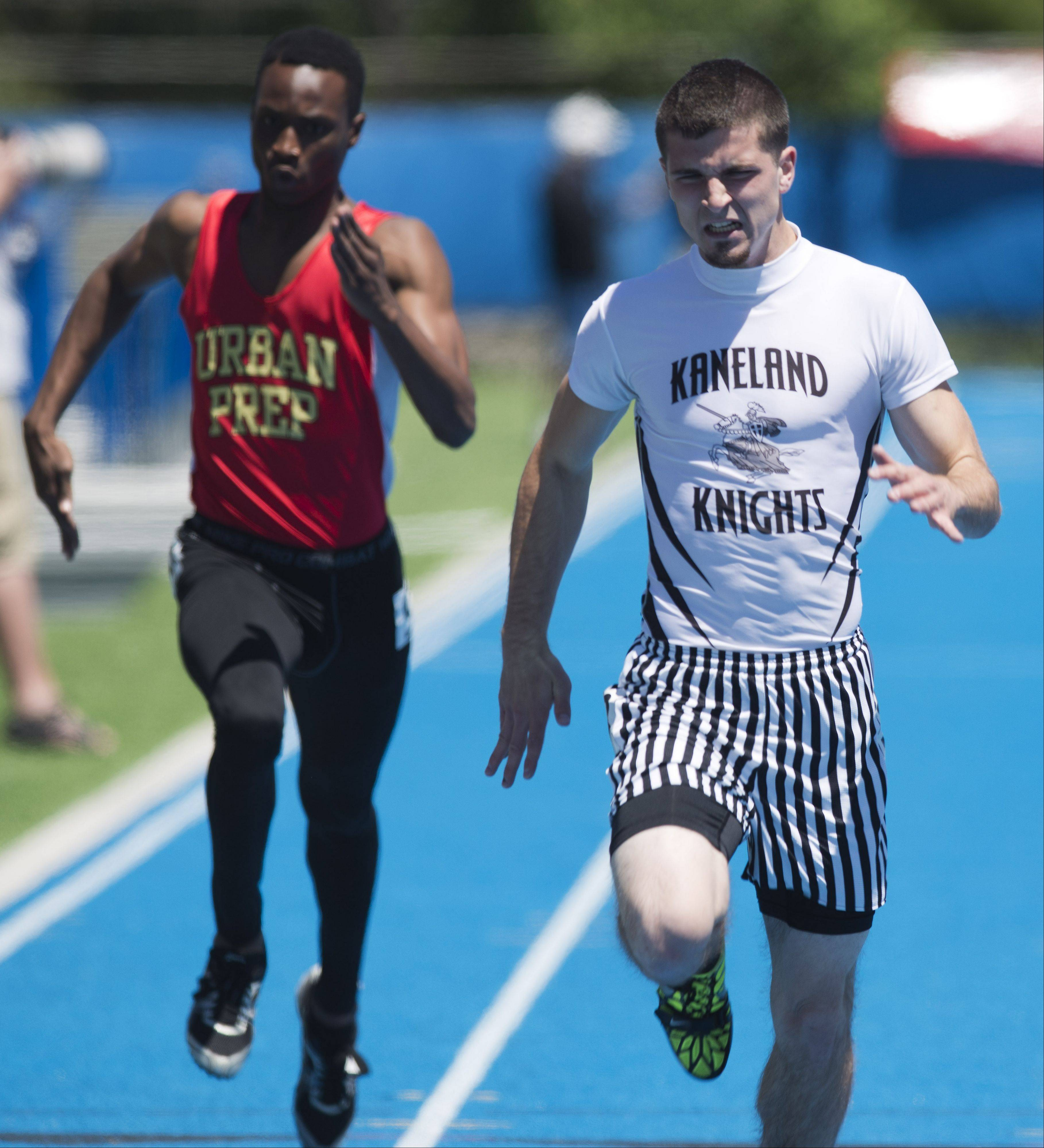 Kaneland's Brandon Bishop crosses the finish line in the Class 2A 200-meter dash during the boys track and field state meet preliminaries in Charleston on Friday.