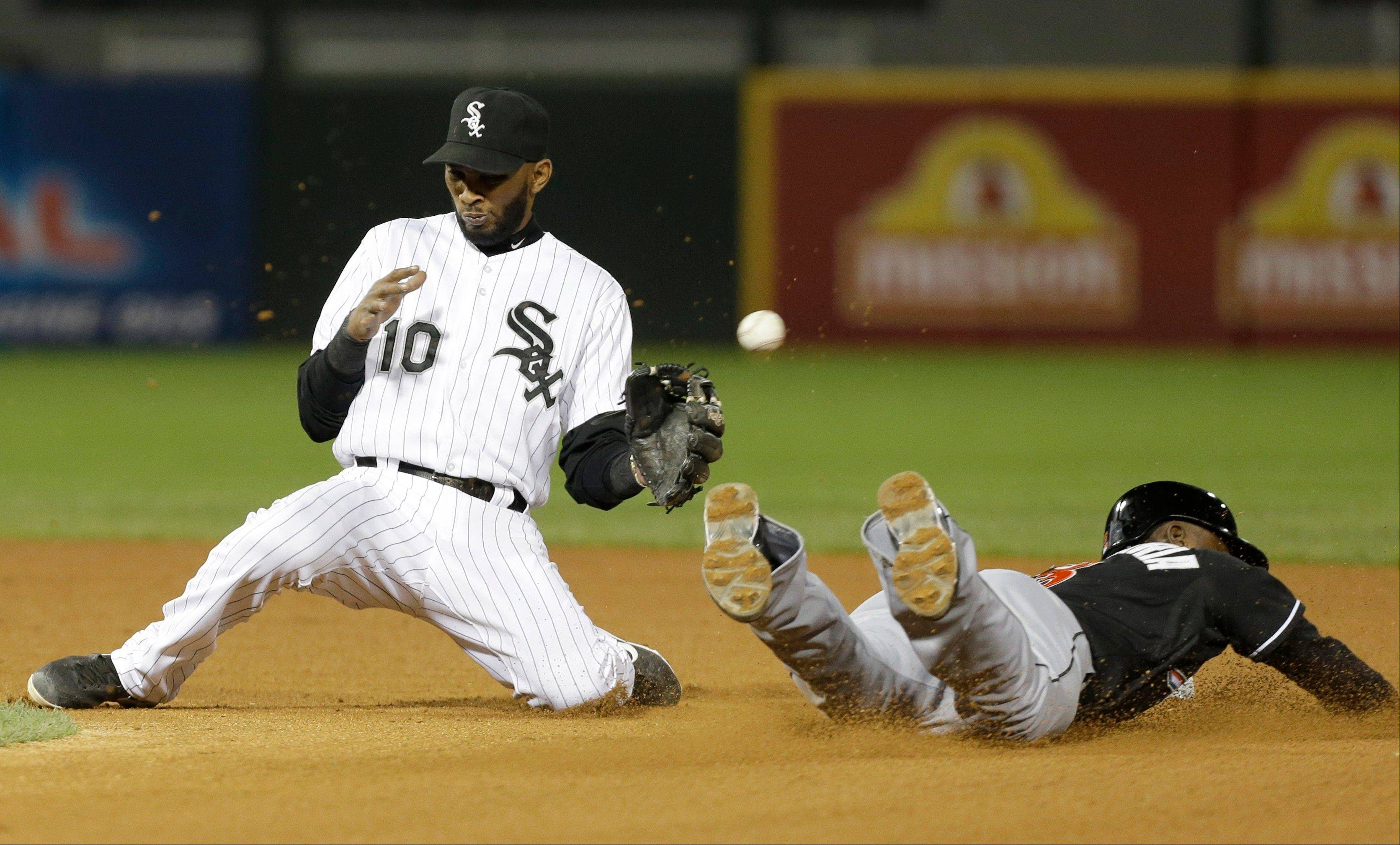 Miami Marlins' Adeiny Hechavarria, right, steals second as Chicago White Sox shortstop Alexei Ramirez cannot make a catch during the eighth inning of a baseball game on Friday, May 24, 2013, in Chicago.