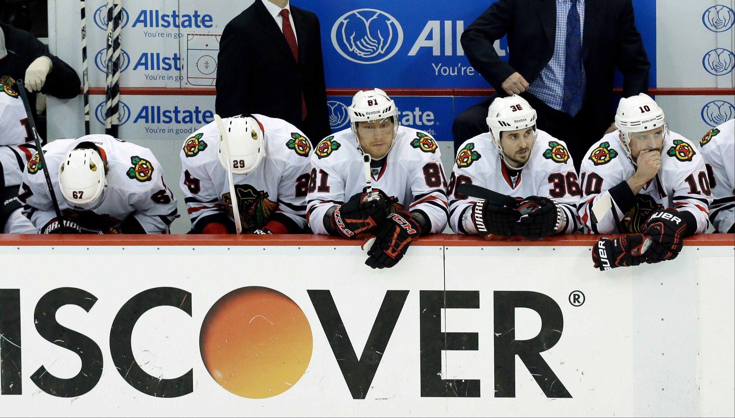 From left to right, Blackhawks Michael Frolik (67), Bryan Bickell (29), Marian Hossa (81), Dave Bolland (36) and Patrick Sharp (10) watch from the bench during Thursday night's Game 4 loss at Detroit. The Hawks are staying positive, knowing that a victory in Saturday night's Game 5 at the United Center could be the start of turning the series around.