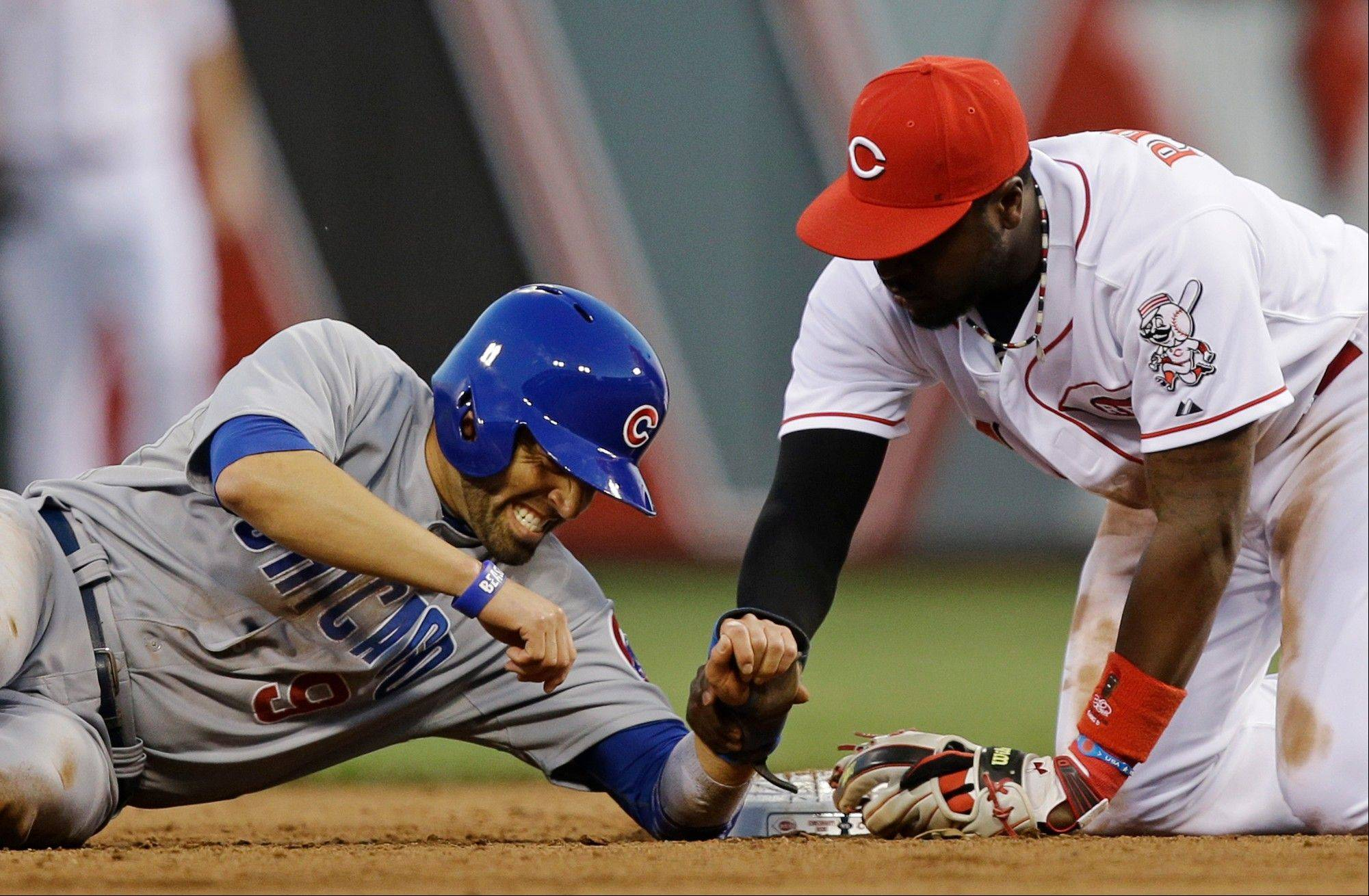 Chicago Cubs' David DeJesus (9) reacts after being forced out at second base by Cincinnati Reds second baseman Brandon Phillips in the fifth inning of a baseball game on Friday, May 24, 2013, in Cincinnati. (AP Photo/Al Behrman)