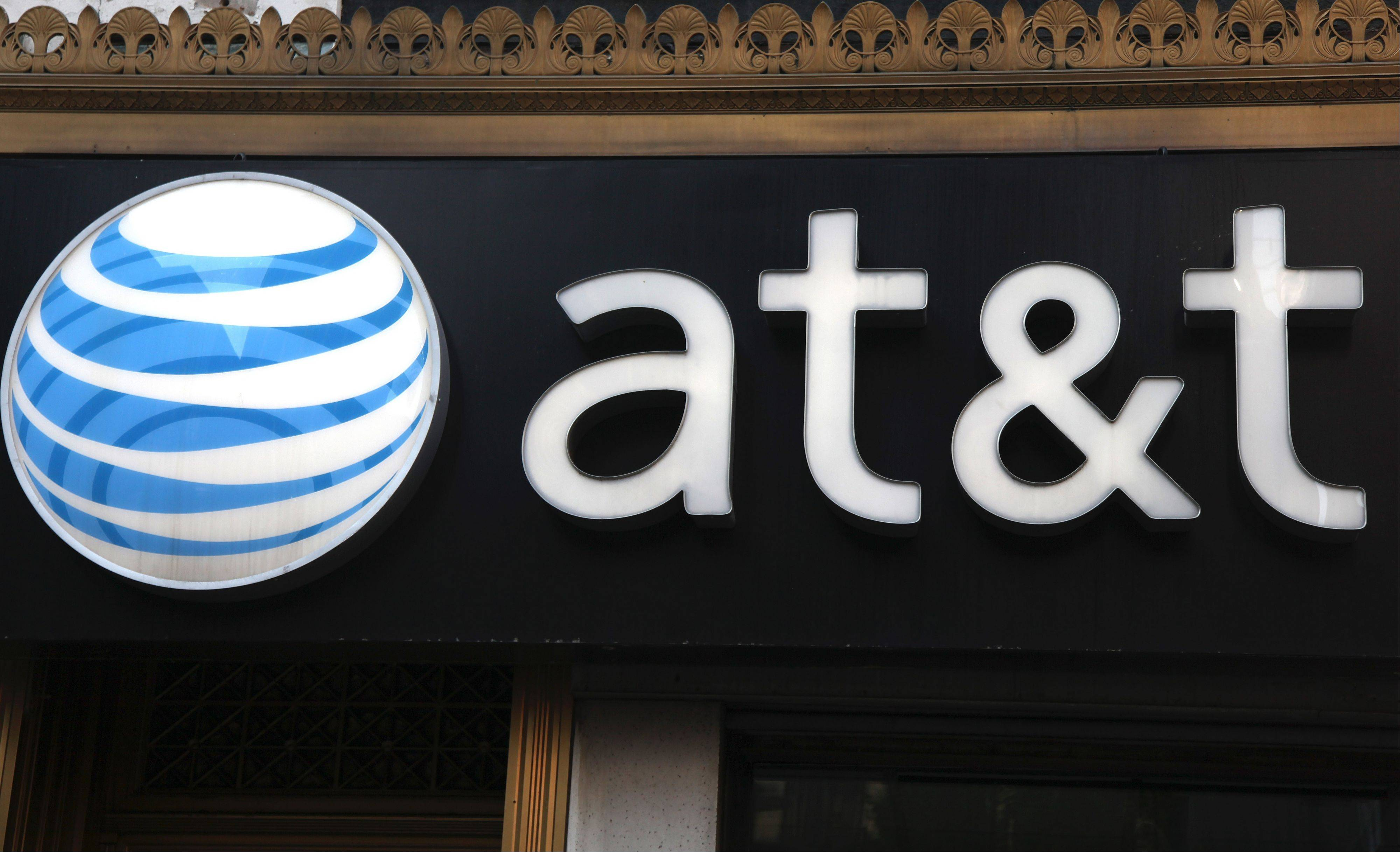 ASSOCIATED PRESS FILE PHOTOThe AT&T logo is displayed on an AT&T Wireless retail store front. AT&T said it has completed its LTE 4G rollout in many Northwest suburbs.