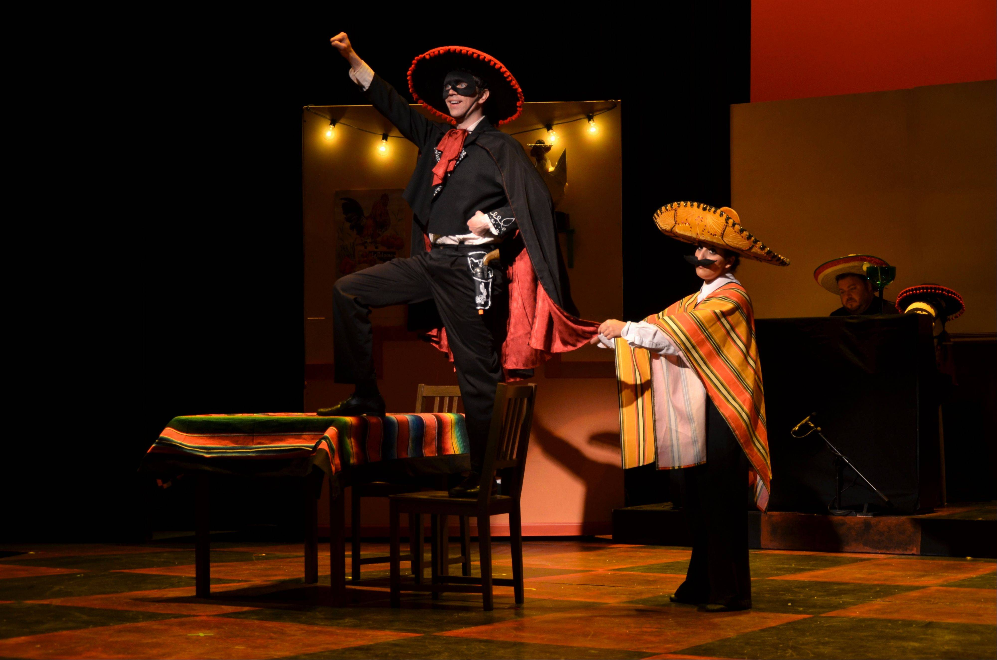 "Dashing bandito Guillermo (Greg Foster, left), celebrates himself in song, while a skeptical Ernesto (Amy Malouf) stands by in ""Five Course Love,"" a musical revue that examines romance in five different restaurants. The Metropolis Performing Arts Centre production runs through June 16."