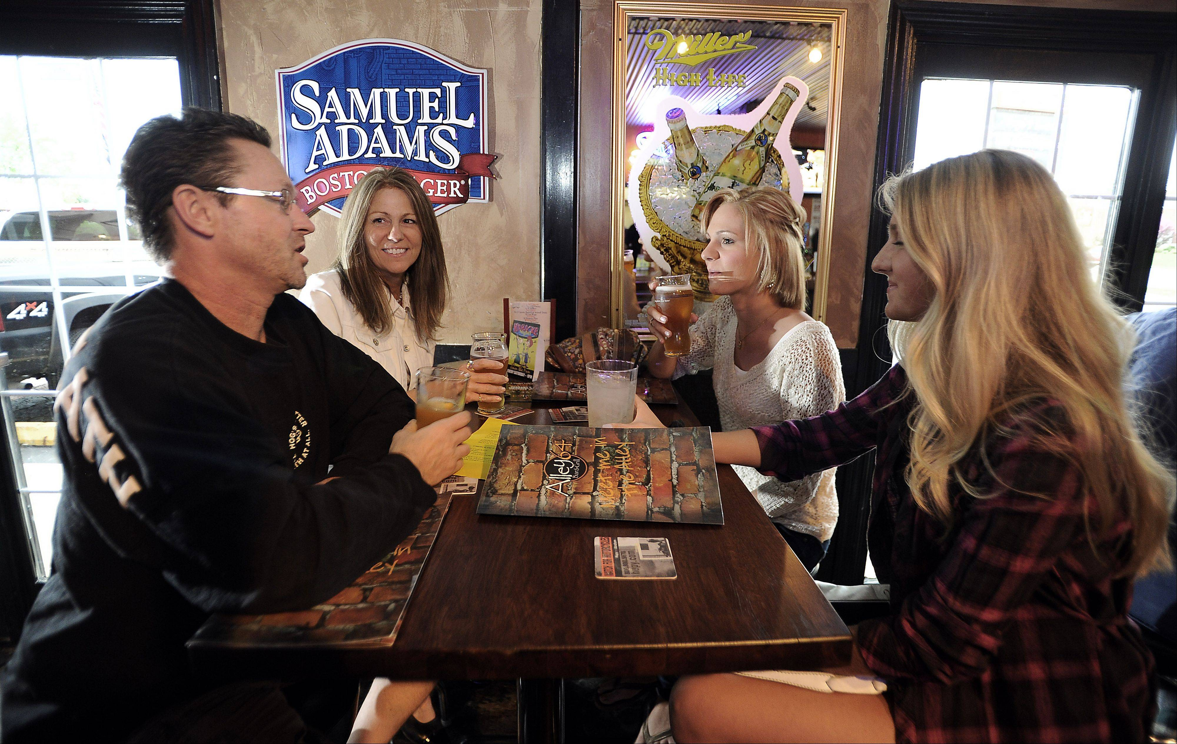 Steve and Jennifer Dee of Long Grove entertain their daughters Taylor and Mackenzie at Alley 64 in Palatine.