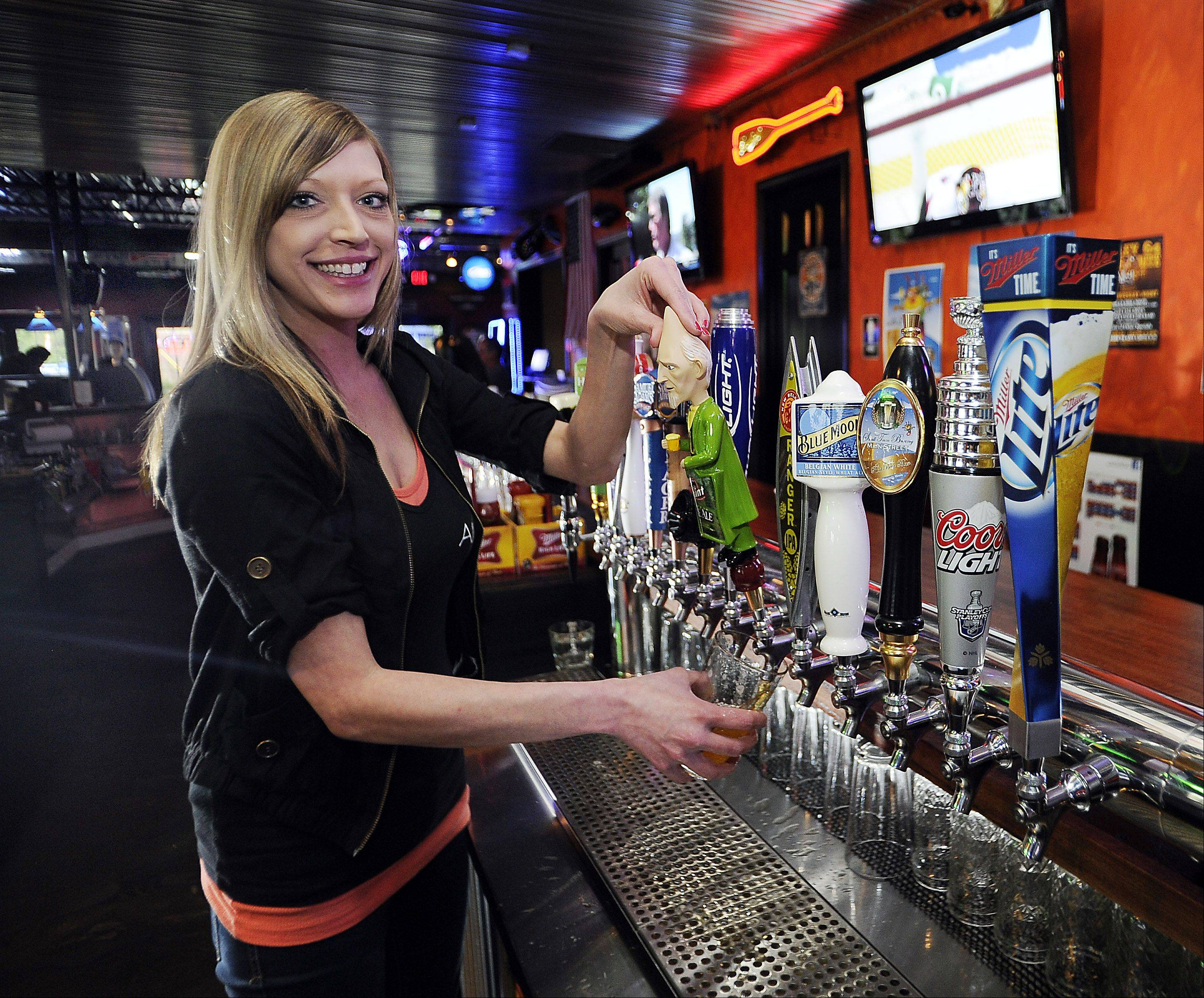 Denise Mamrot pours a beer at Alley 64 in Palatine.
