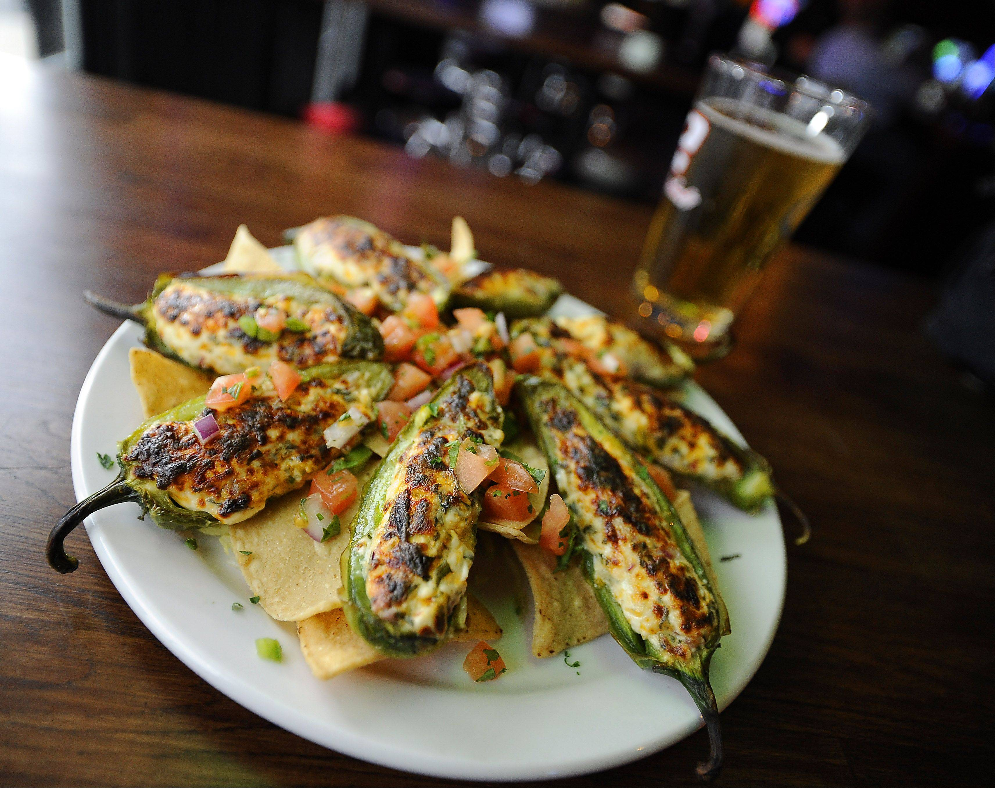 Alley 64's grilled poppers pack plenty of heat. Grilled jalape�os are stuffed with cheese and served with diced tomatoes and onions over tortilla chips.