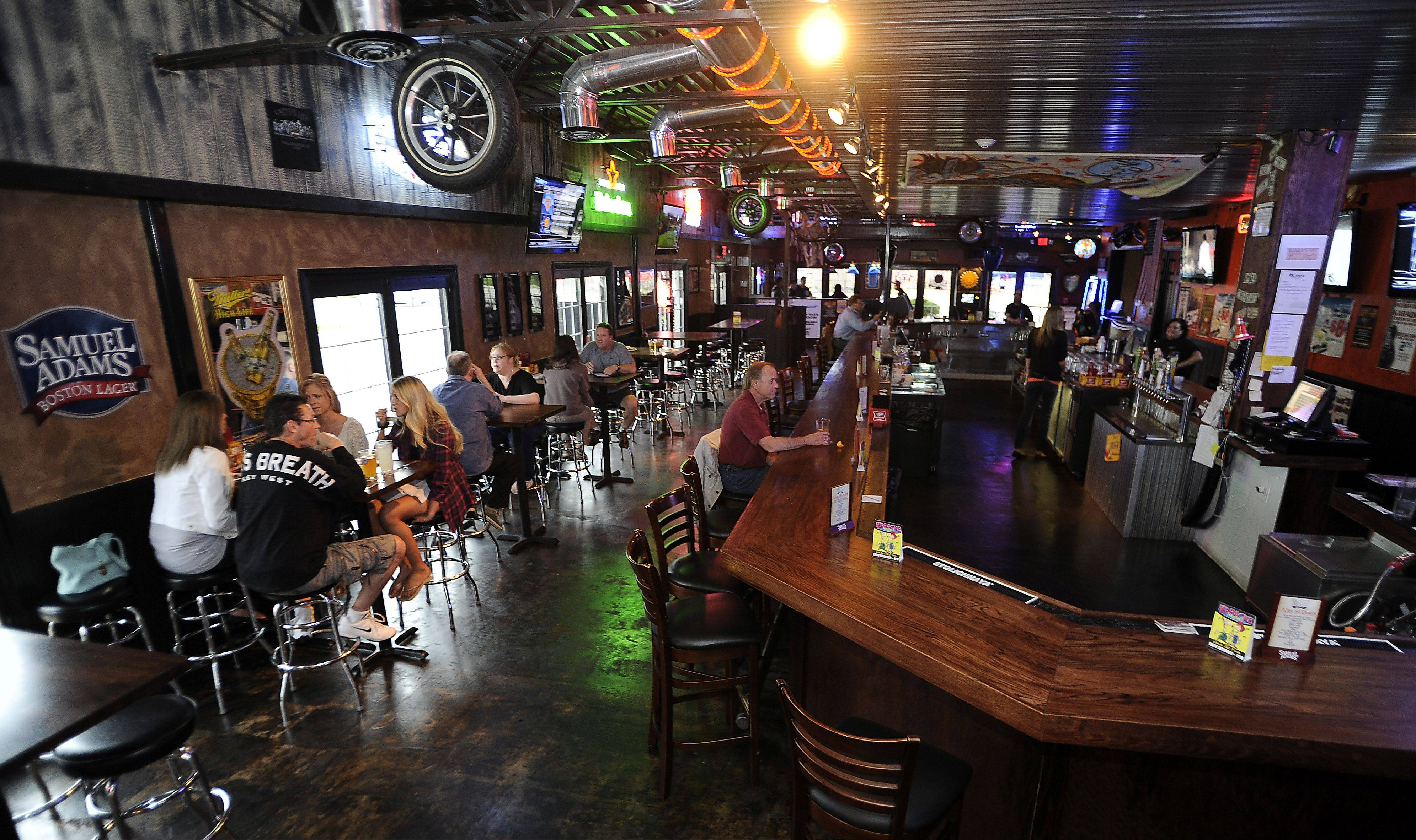 Bike parts and tires reinforce the Harley theme at Alley 64 in Palatine.