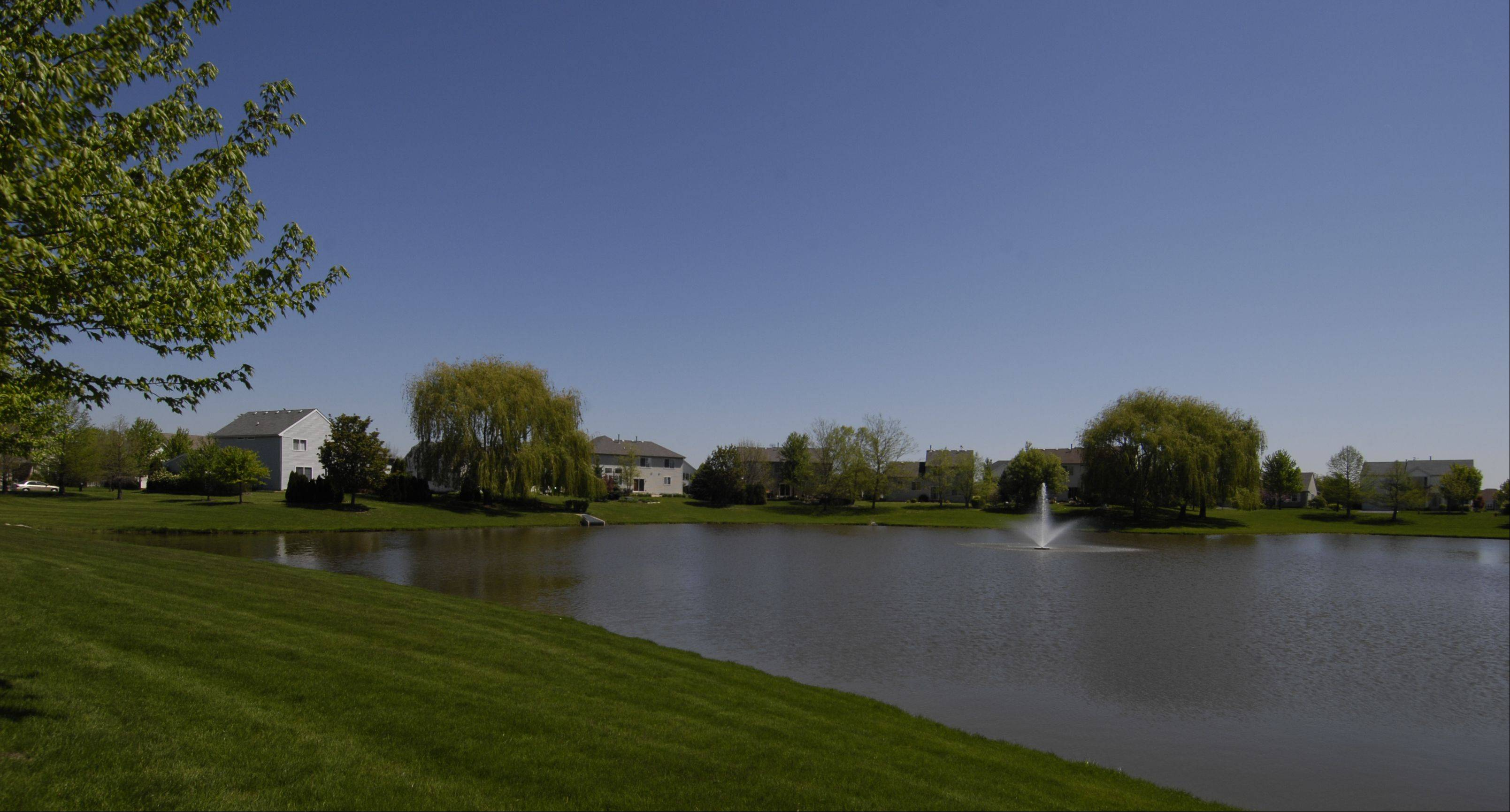 A small lake is an attractive feature of the Orchard Crossing neighborhood.