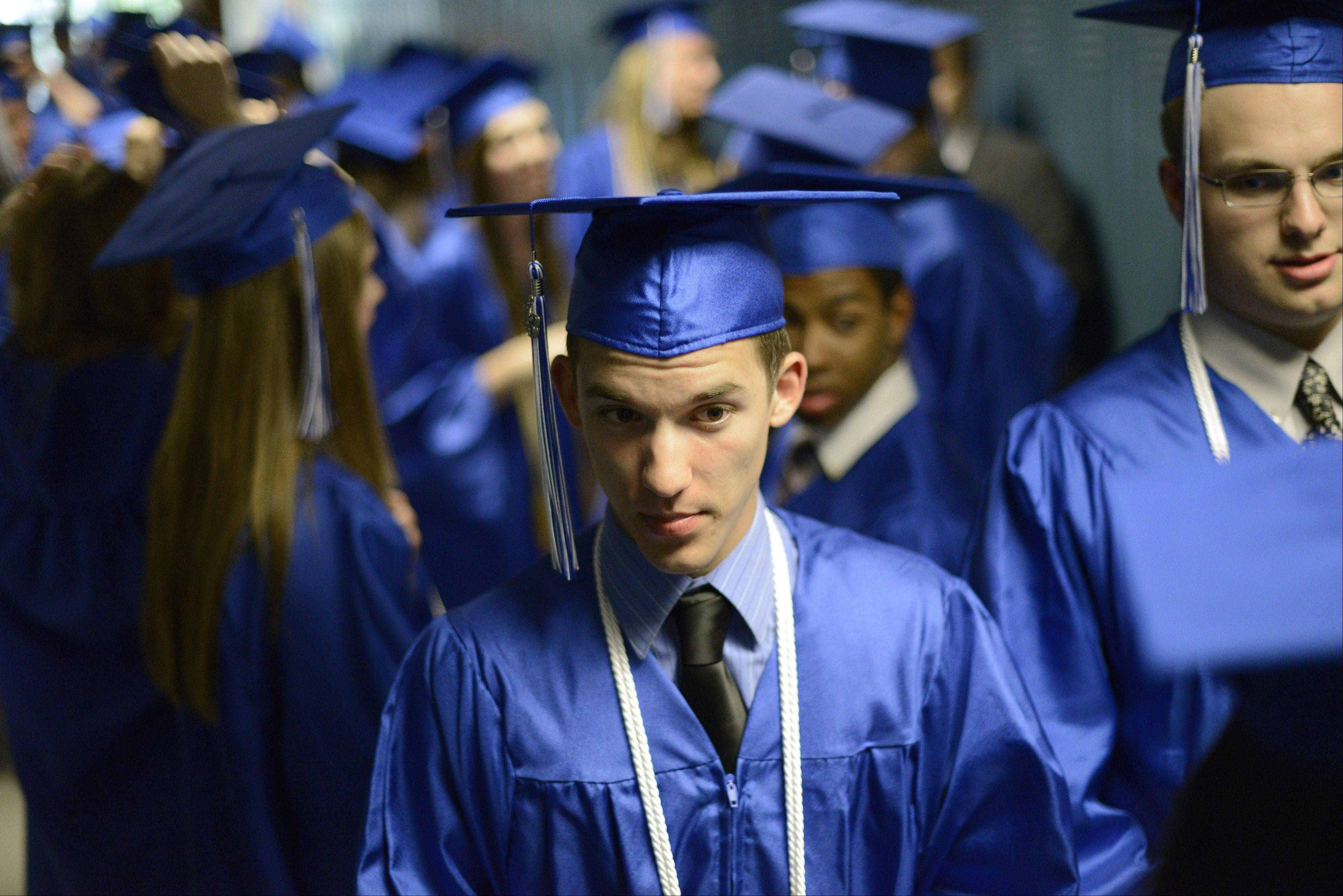 Jonathan Janik, 18, of Elgin waits for Westminster Christian High School's commencement ceremony to begin on Friday, May 24.