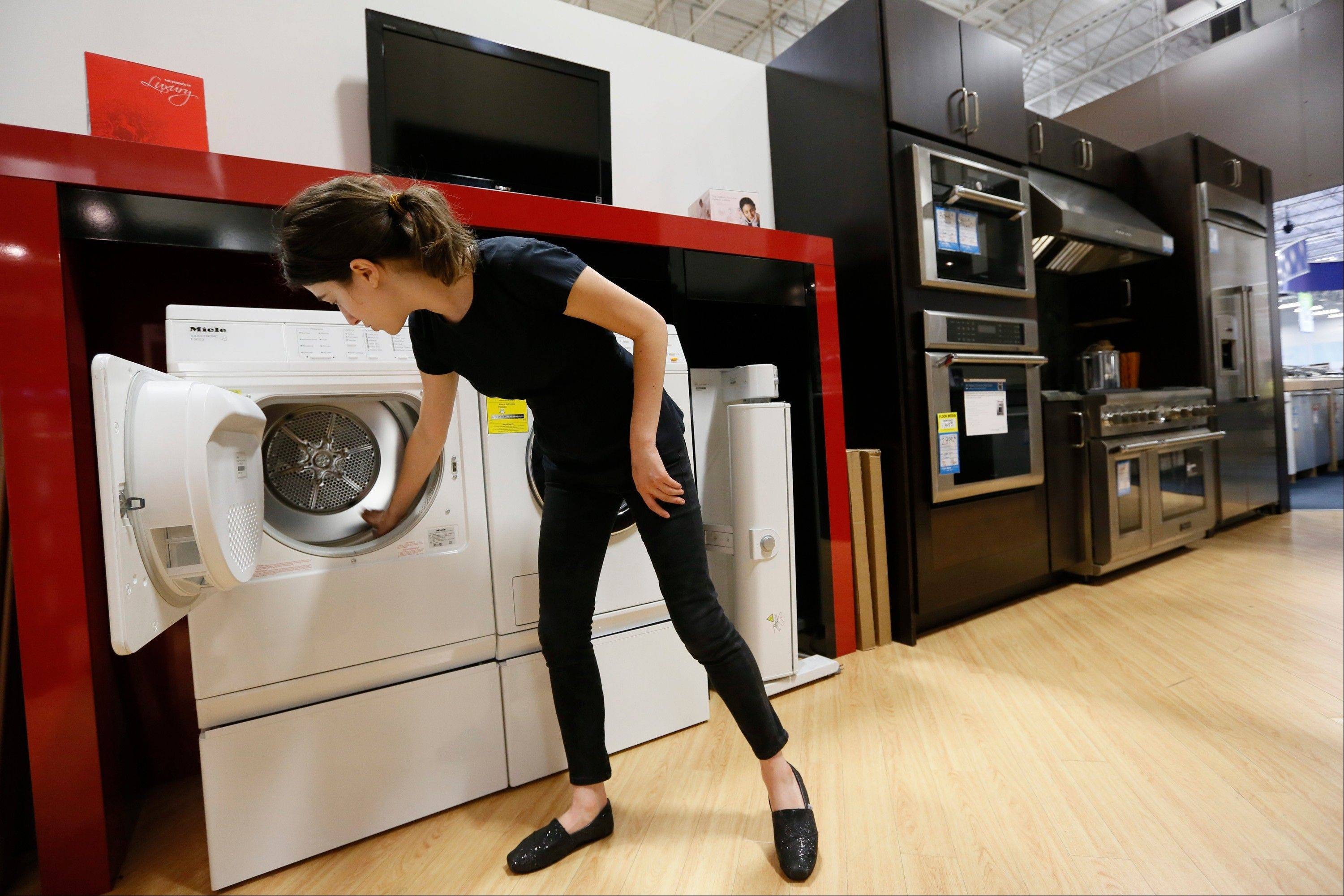 Miele Account Manager Natasha Feldman showcases Miele washer and dryer energy efficient appliances at the Pacific Sales at the Best Buy store in Glendale, Calif.