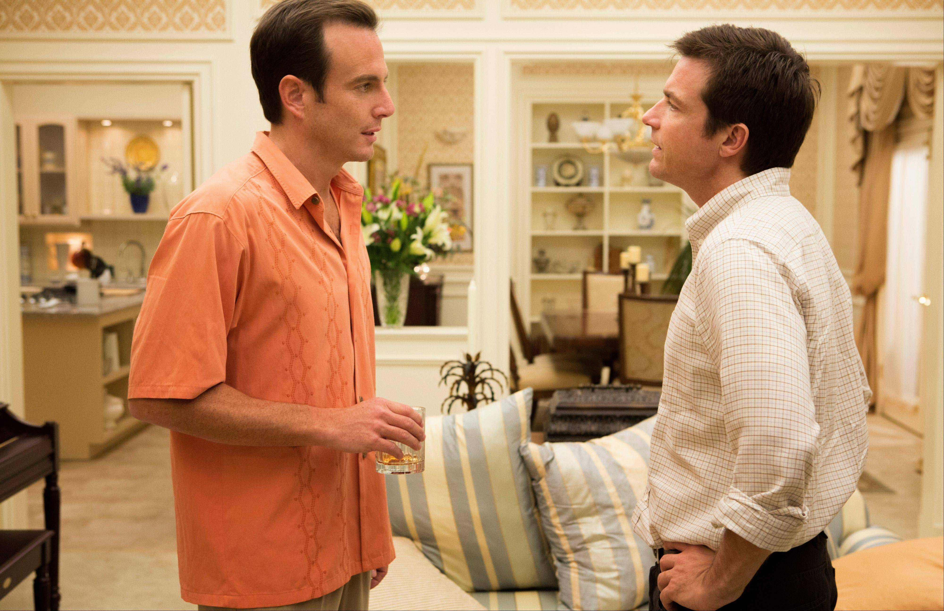 "This undated publicity photo released by Netflix shows Will Arnett, left, and Jason Bateman in a scene from ""Arrested Development,"" premiering May 26, 2013 on Netflix."
