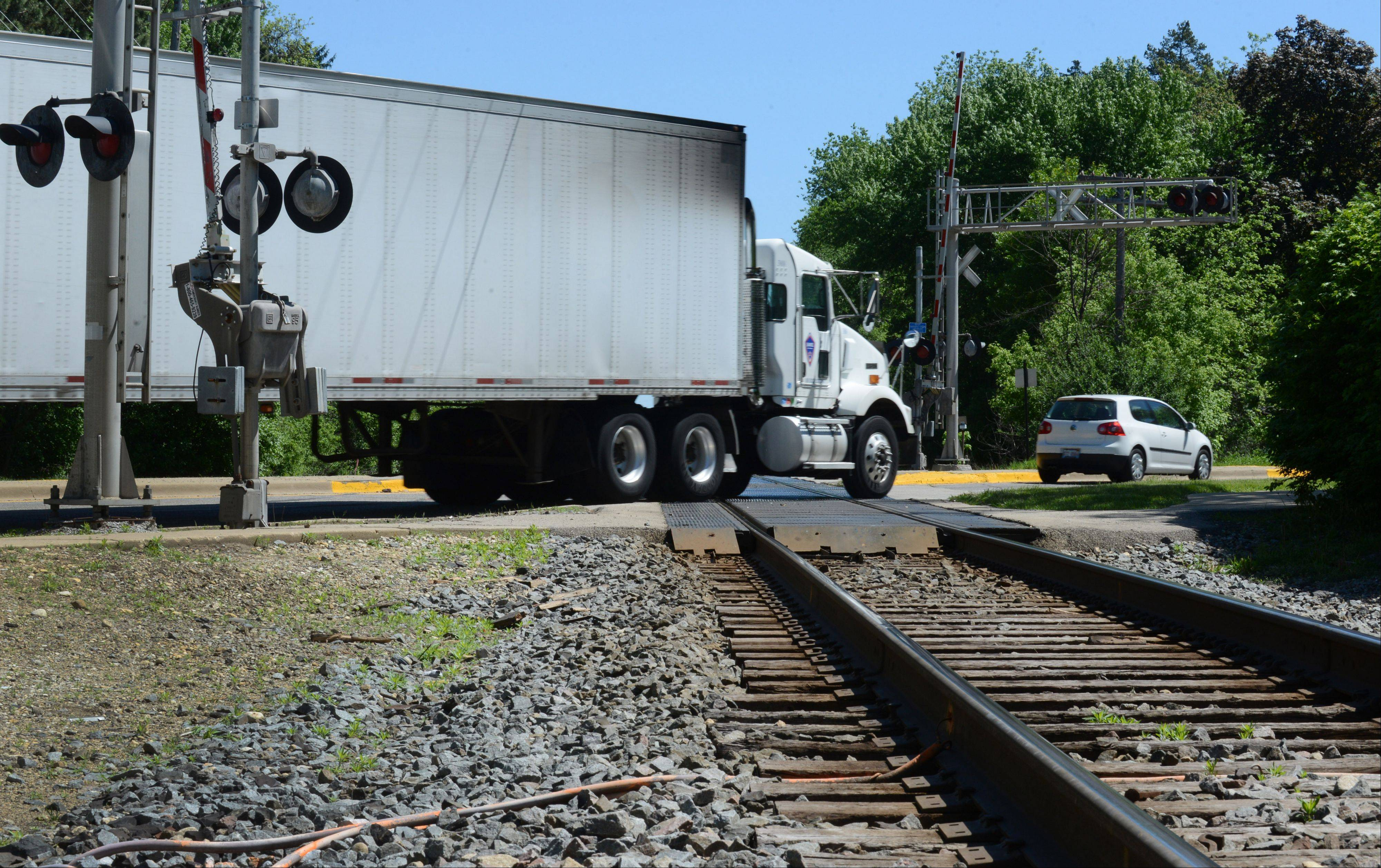 Traffic crosses the CN tracks over Route 14 in Barrington Friday morning.