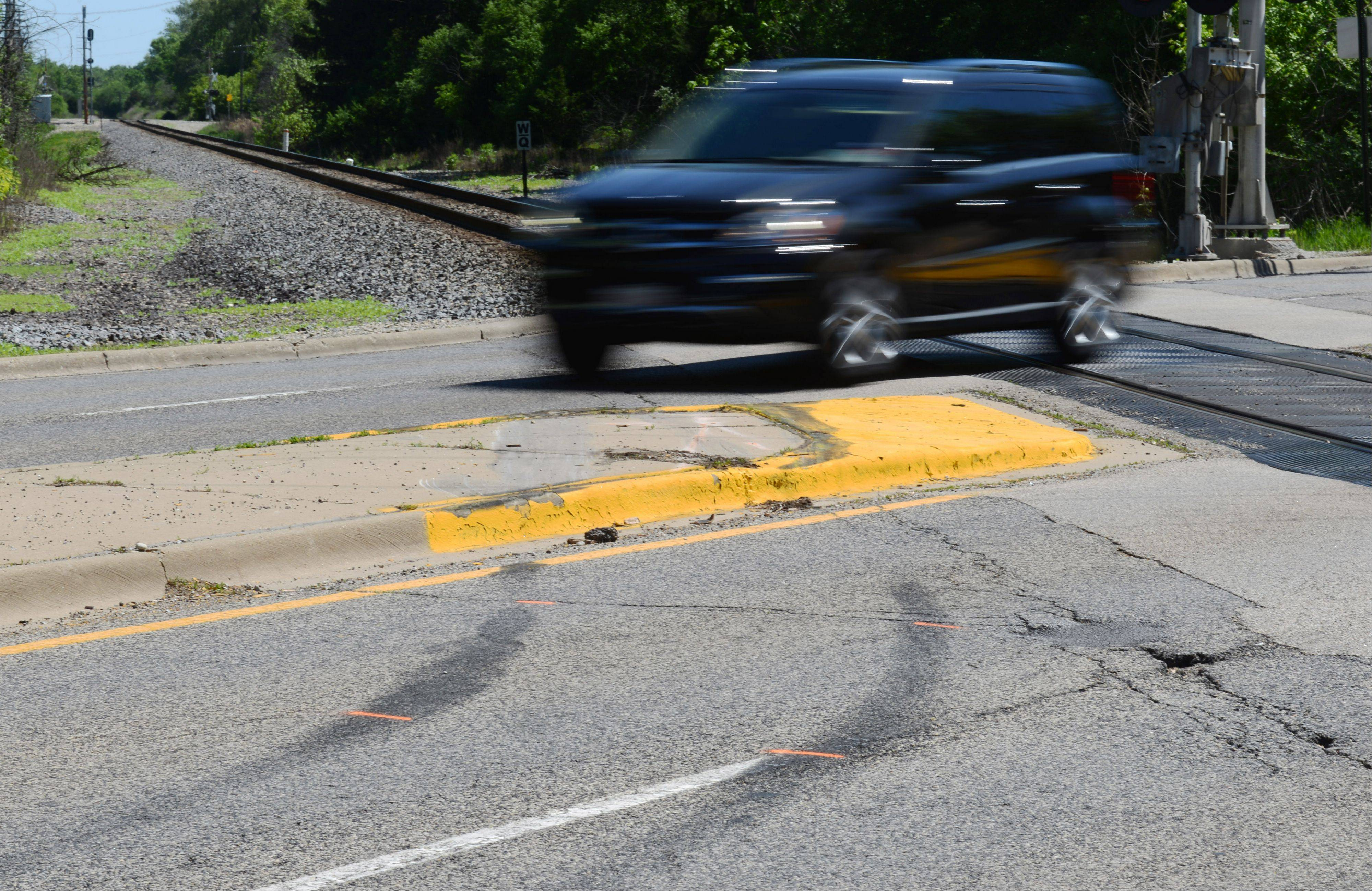 Tire marks and police investigation paint remain on Route 14 at the CN crossing.