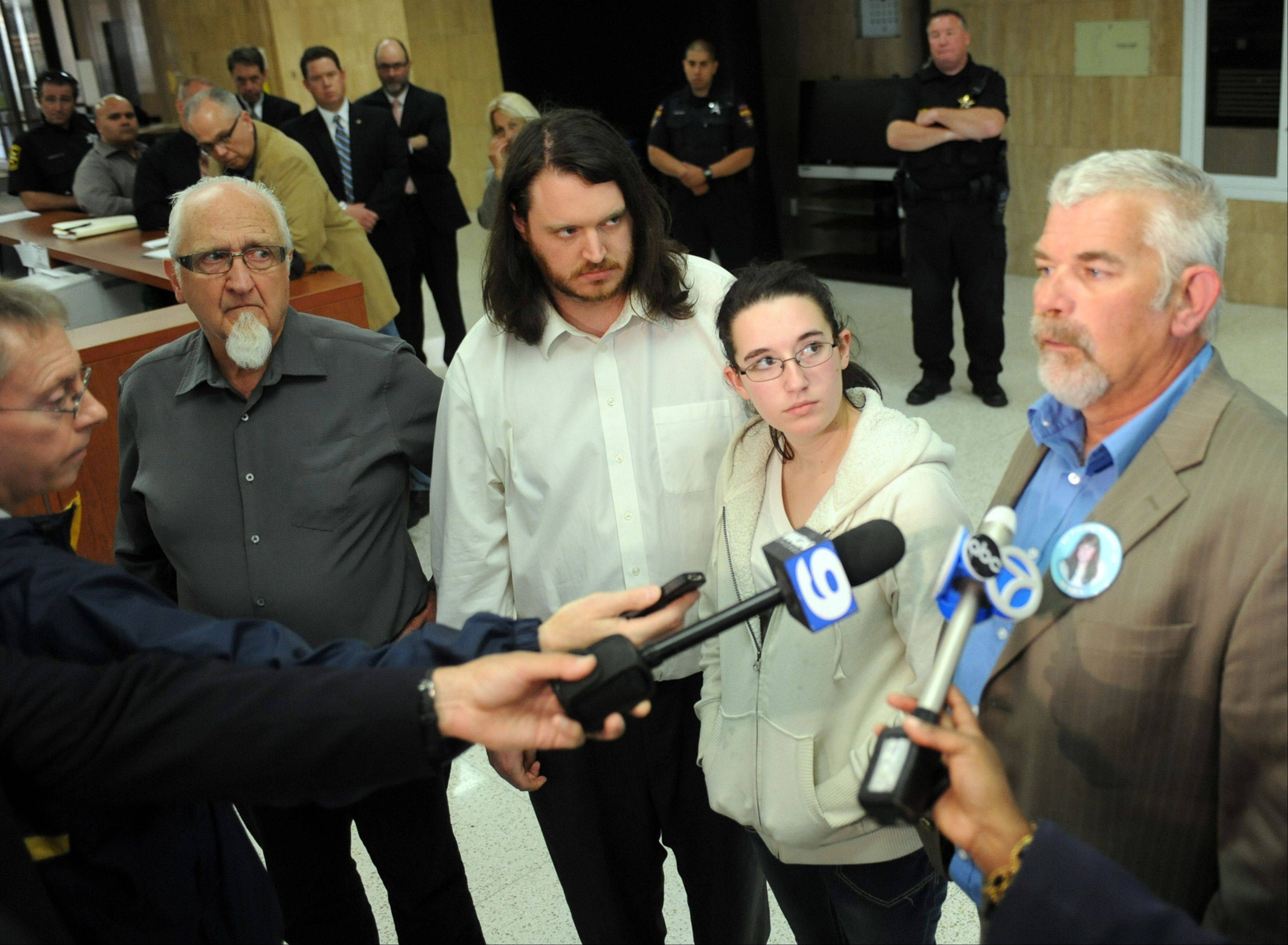 Ken Hutchison talks about the first-degree murder guilty verdict during a news conference in the lobby of the Lake County Courthouse in Waukegan with Richard Dean (left), Richard Nothnagel and Rebeccah Hutchison.