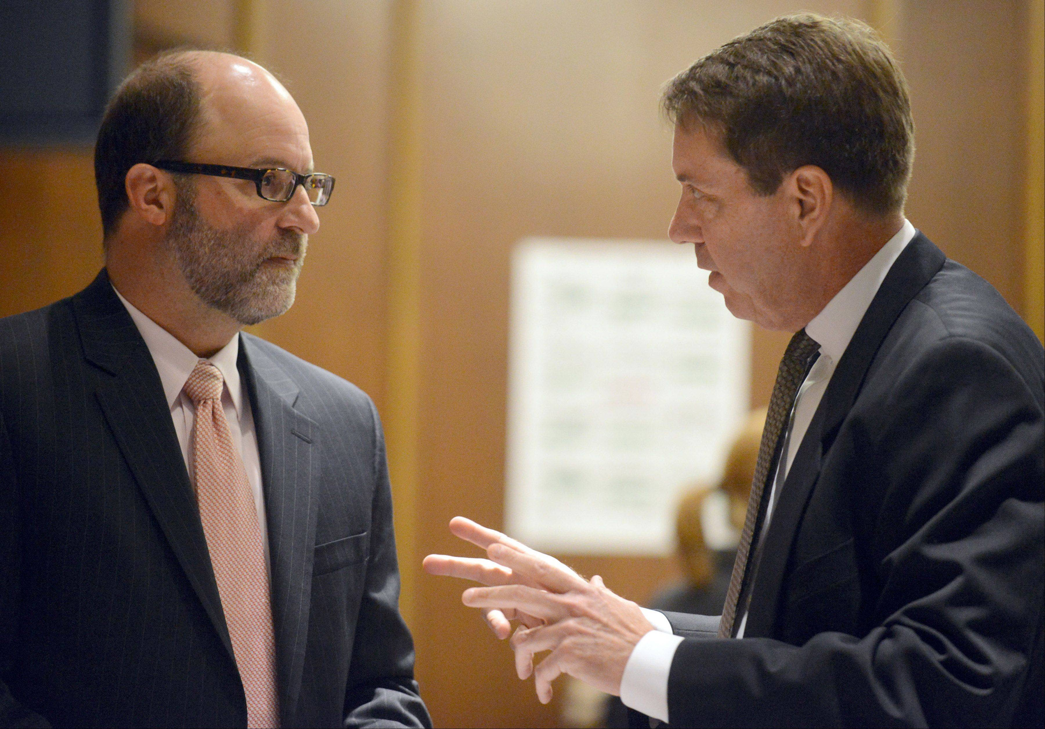 Assistant state's attorneys Steve Scheller, left, and Jeffrey Pavletic discuss their closing statements in the trial of James Ealy, 48, of Lake Villa on Friday in Waukegan.