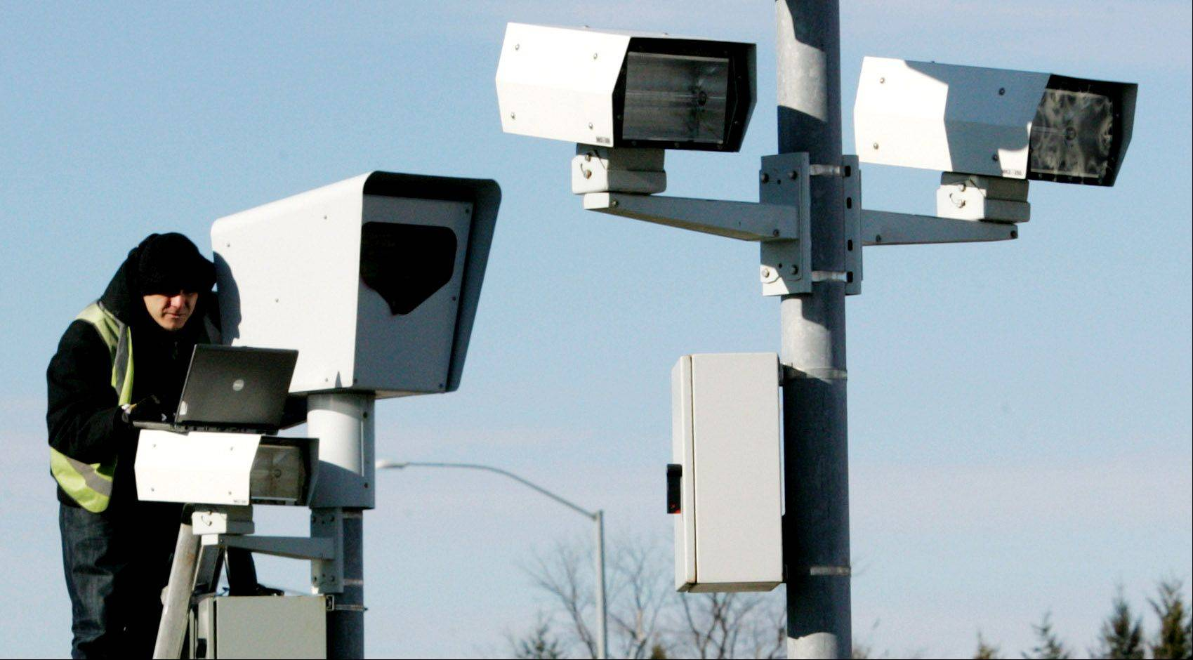 Gurnee's red-light camera intersections include Hunt Club Road and Grand Avenue. The village is owed about $1.5 million in photo enforcement fines and has turned to a state agency's program for assistance to collect the debt.