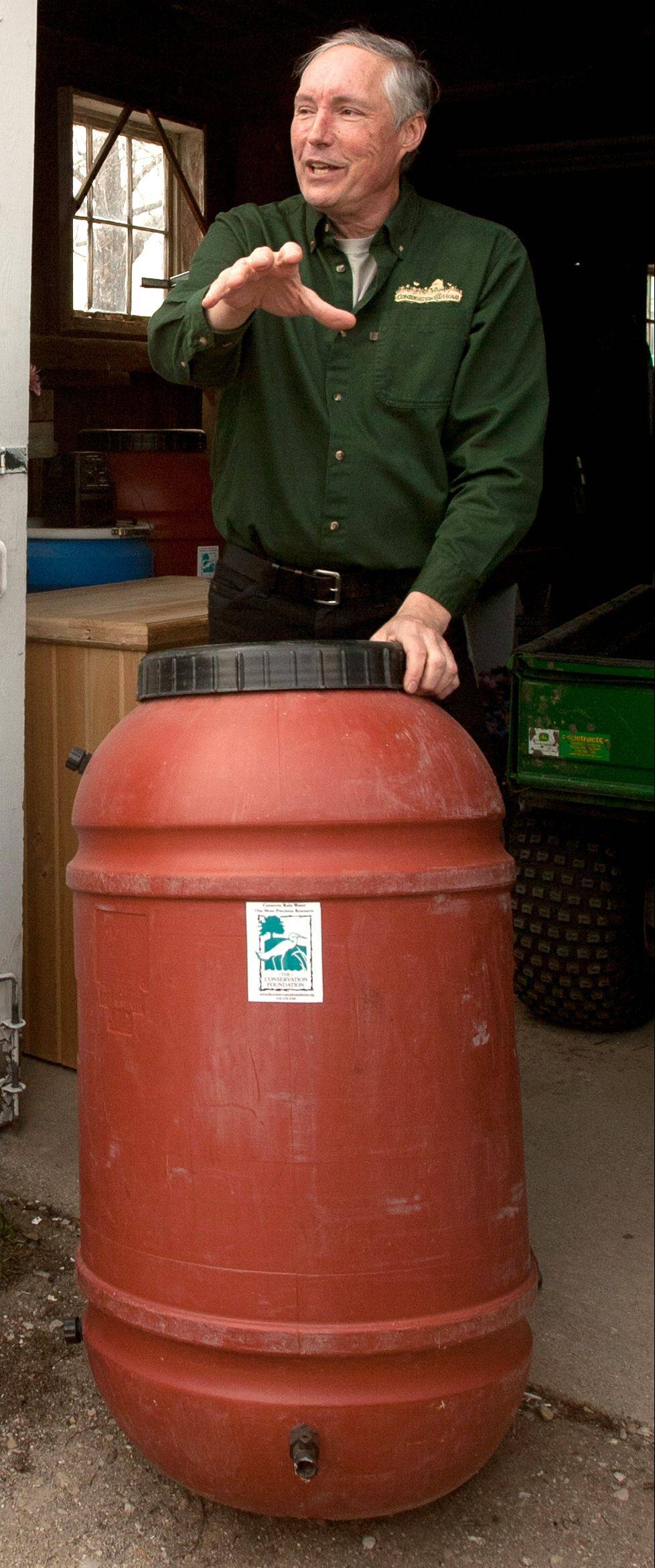 Jim Kleinwachter of the Conservation Foundation talks about rain barrels at the McDonald Farm in Naperville.