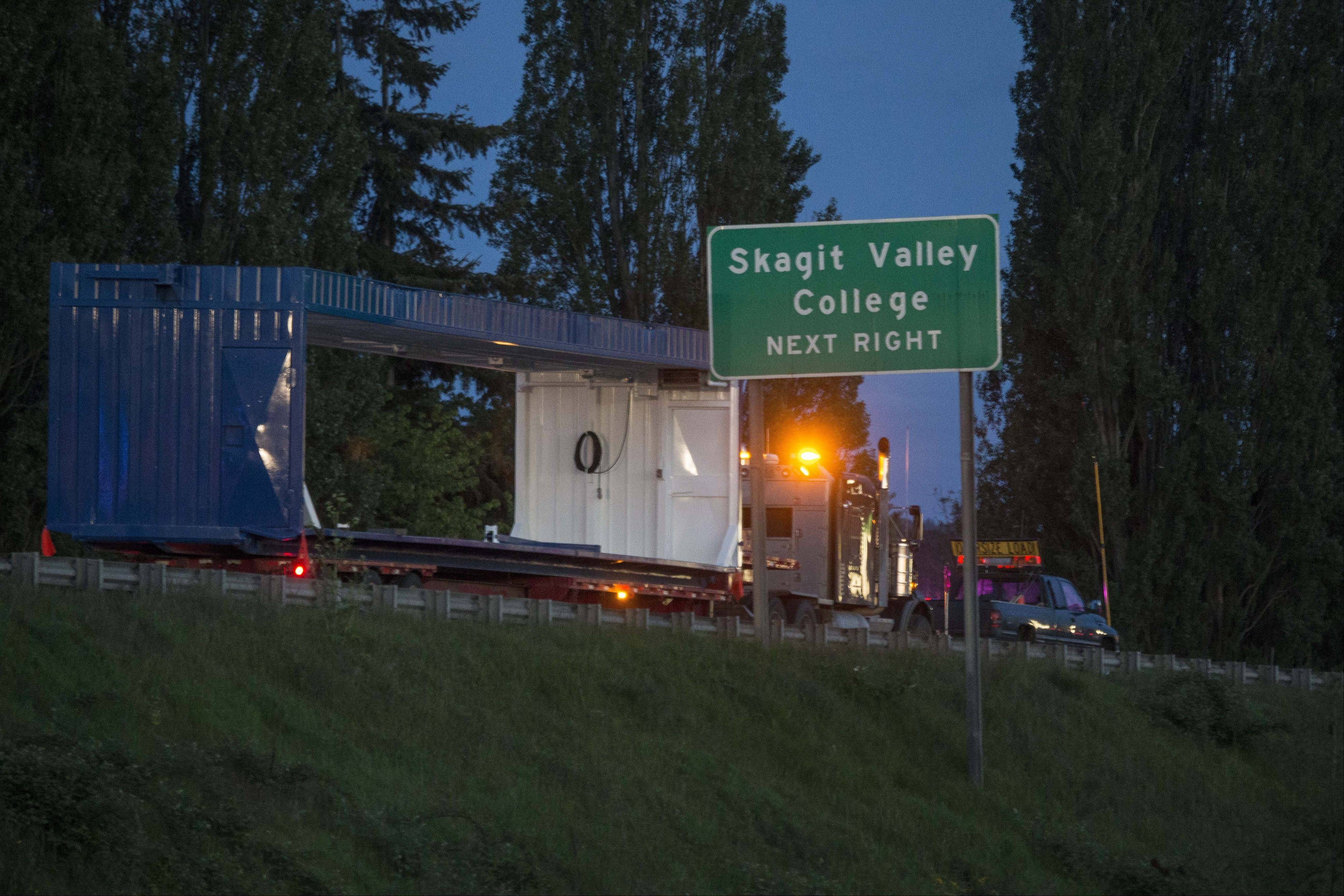 An Interstate 5 bridge over a Skagit river collapsed north of Seattle Thursday evening May 23, 2013, dumping two vehicles into the water and sparking a rescue effort by boats and divers as three injured people were pulled from the chilly waterway. Washington State Patrol Chief John Batiste says this tractor-trailer carrying a tall load hit an upper part of the span, causing the collapse.