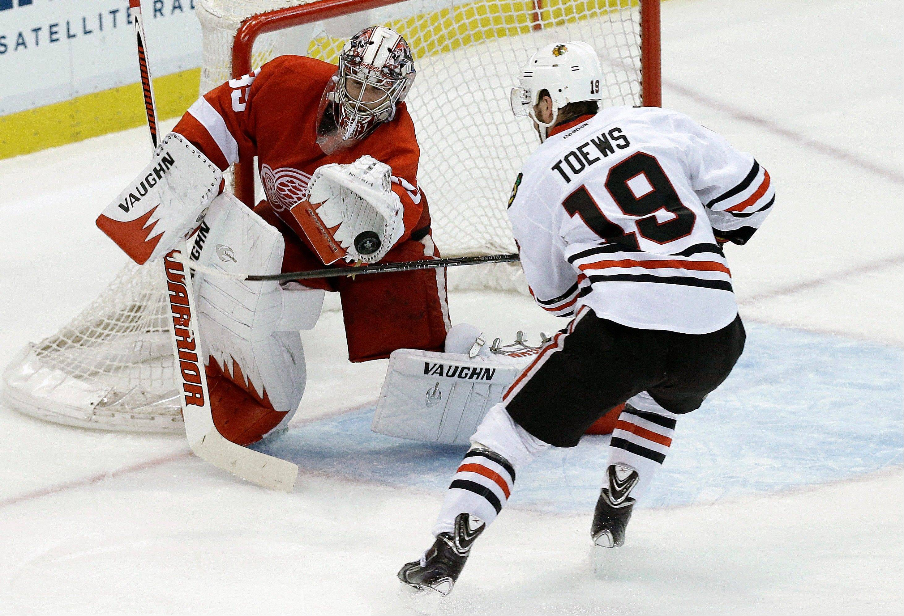 Detroit Red Wings goalie Jimmy Howard (35) stops a shot by Blackhawks center Jonathan Toews (19) during the second period in Game 4 of the Western Conference semifinals last night. Even Toews' frustration boiled over as he got angry and incurred penalties.