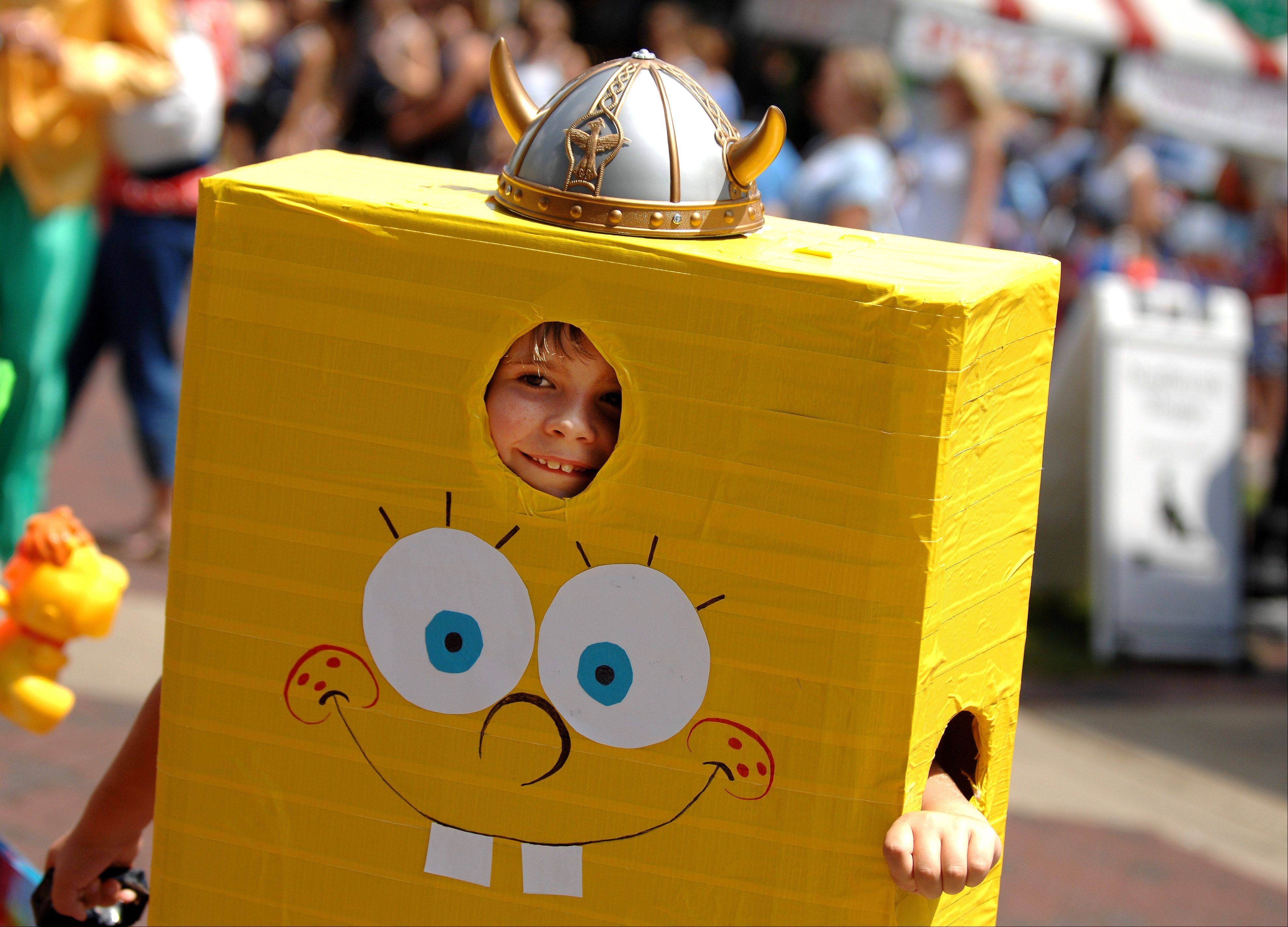 Andrew Mueller, 7, of Geneva flashes a smile from inside his SpongeBob costume during the kids parade at last year's Swedish Days in Geneva. This year's festival will run June 18-23.