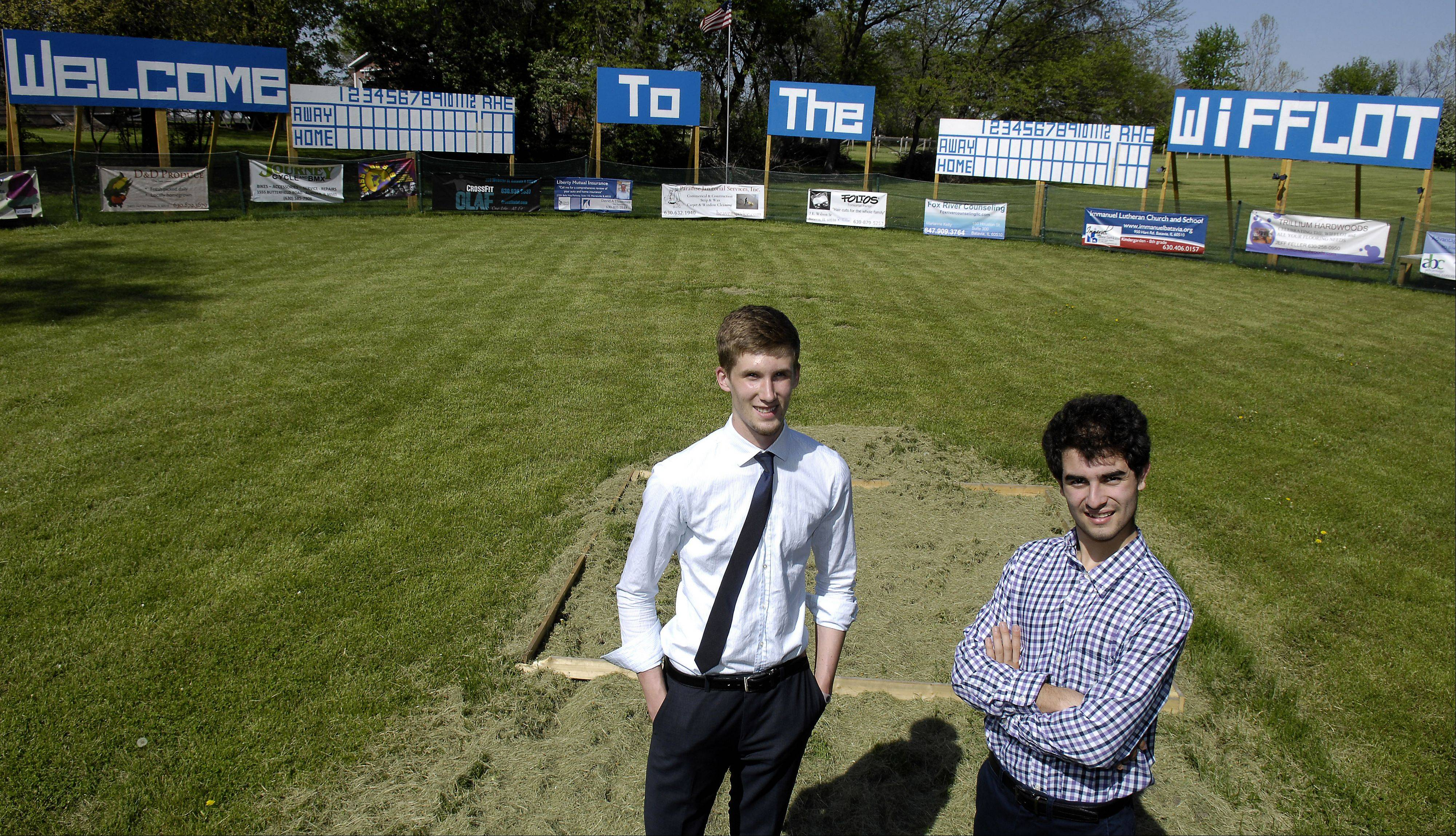 "Batavia High School students Ryan Pawlowski, left, and Andrew Martinez have created and built ""The Wifflot,"" a Wiffle ball field complete with a fence, scoreboard, outfield advertising and an American flag."