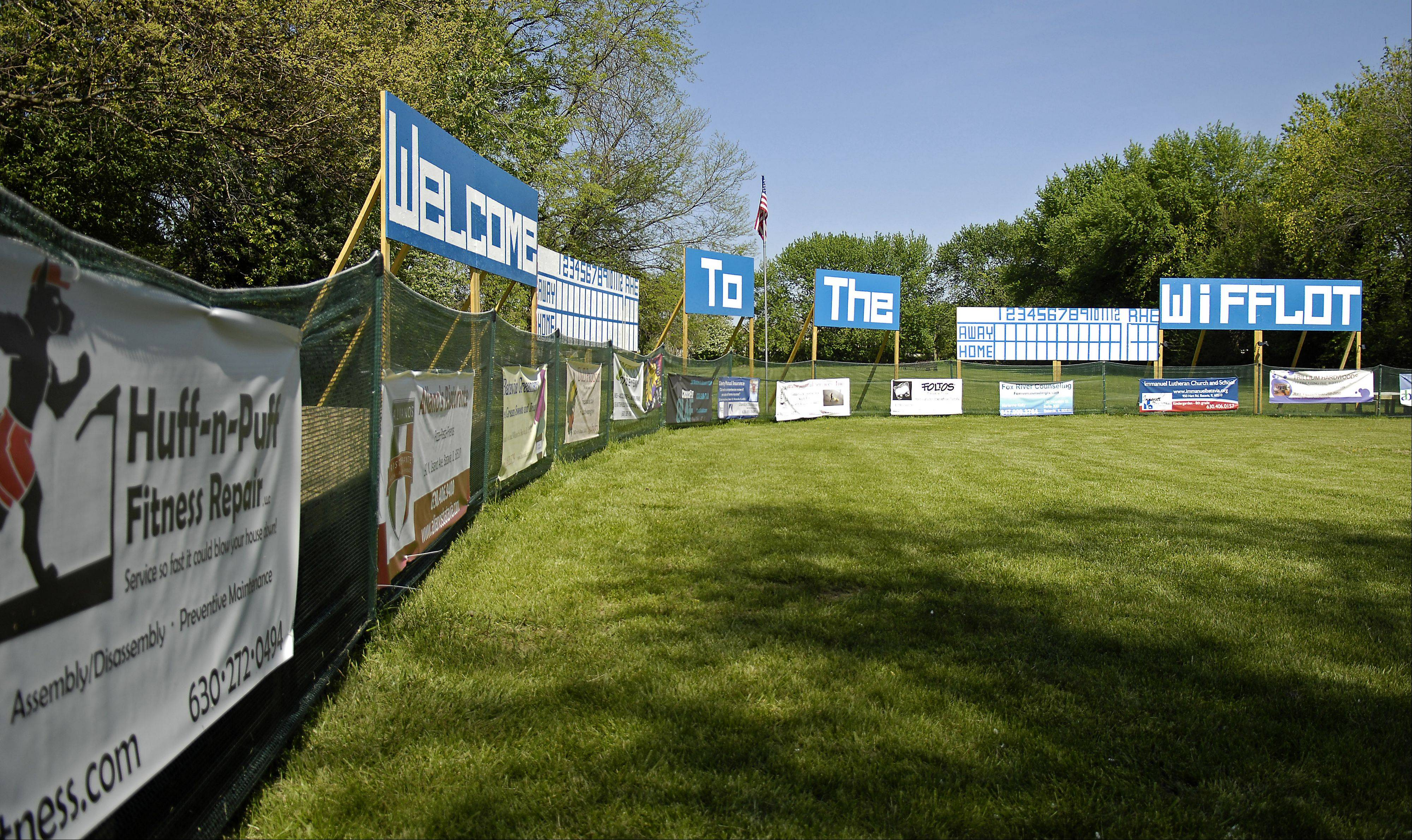 "Advertising adorns the outfield fence of ""The Wifflot"" in Batavia."