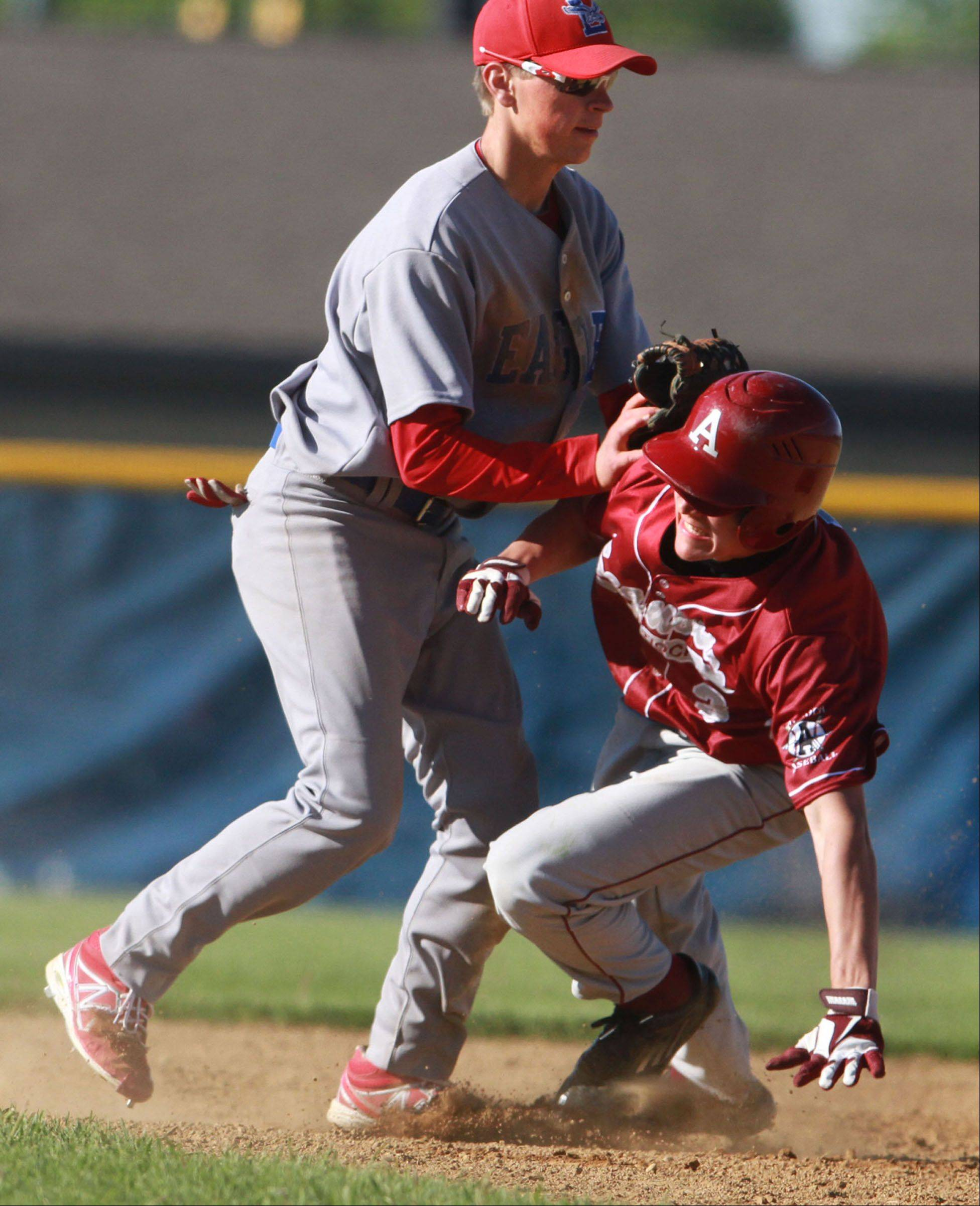Lakes shortstop Nick Seketa tags out Antioch's Collin Prather at second base as Lakes wins the Class 3A regional semifinal at Lakes 1-0 on Friday.