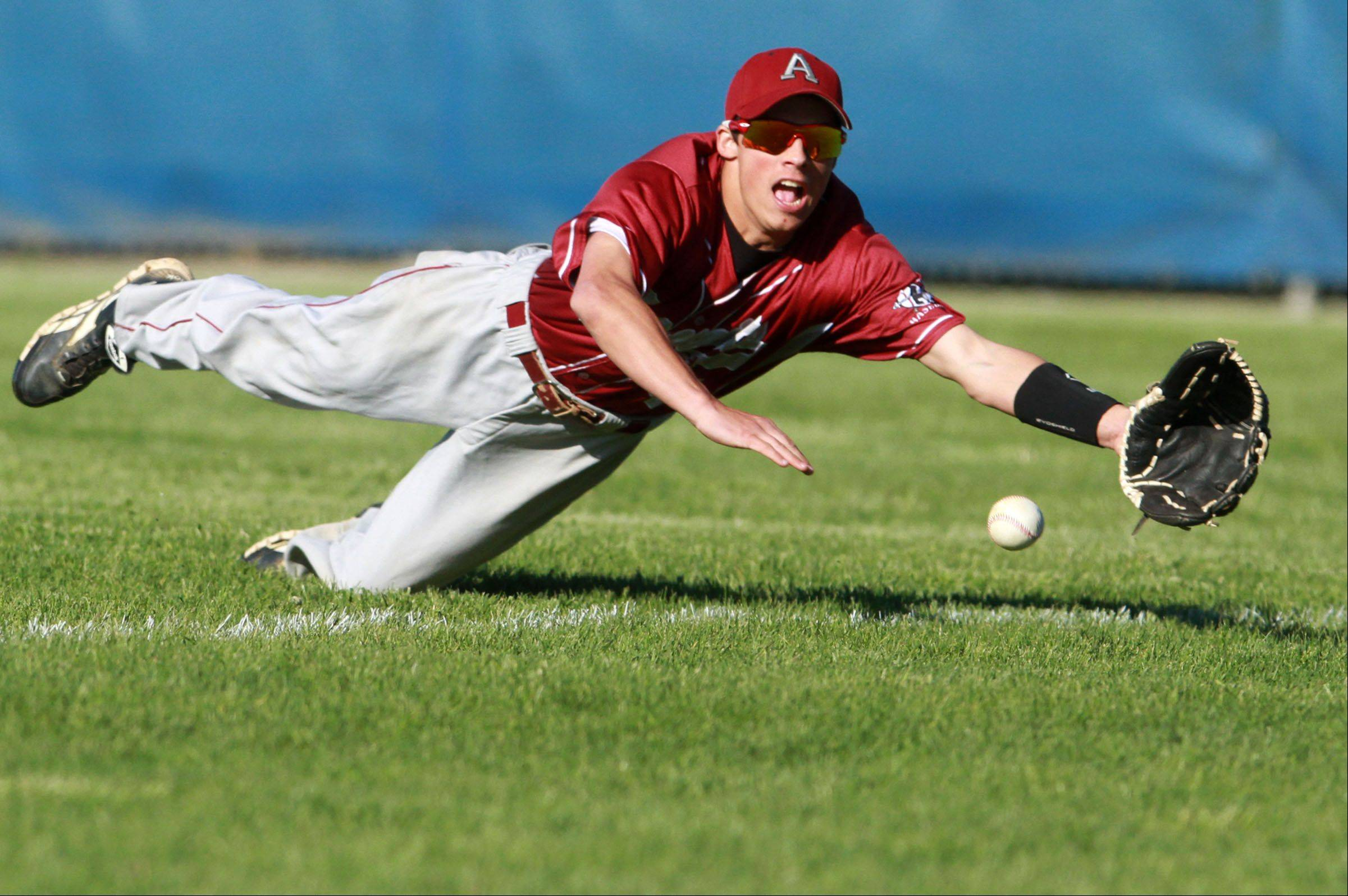 Antioch's Cameron Slate dives for a Lakes hit in right field during Class 3A regional semifinal play Friday at Lakes.