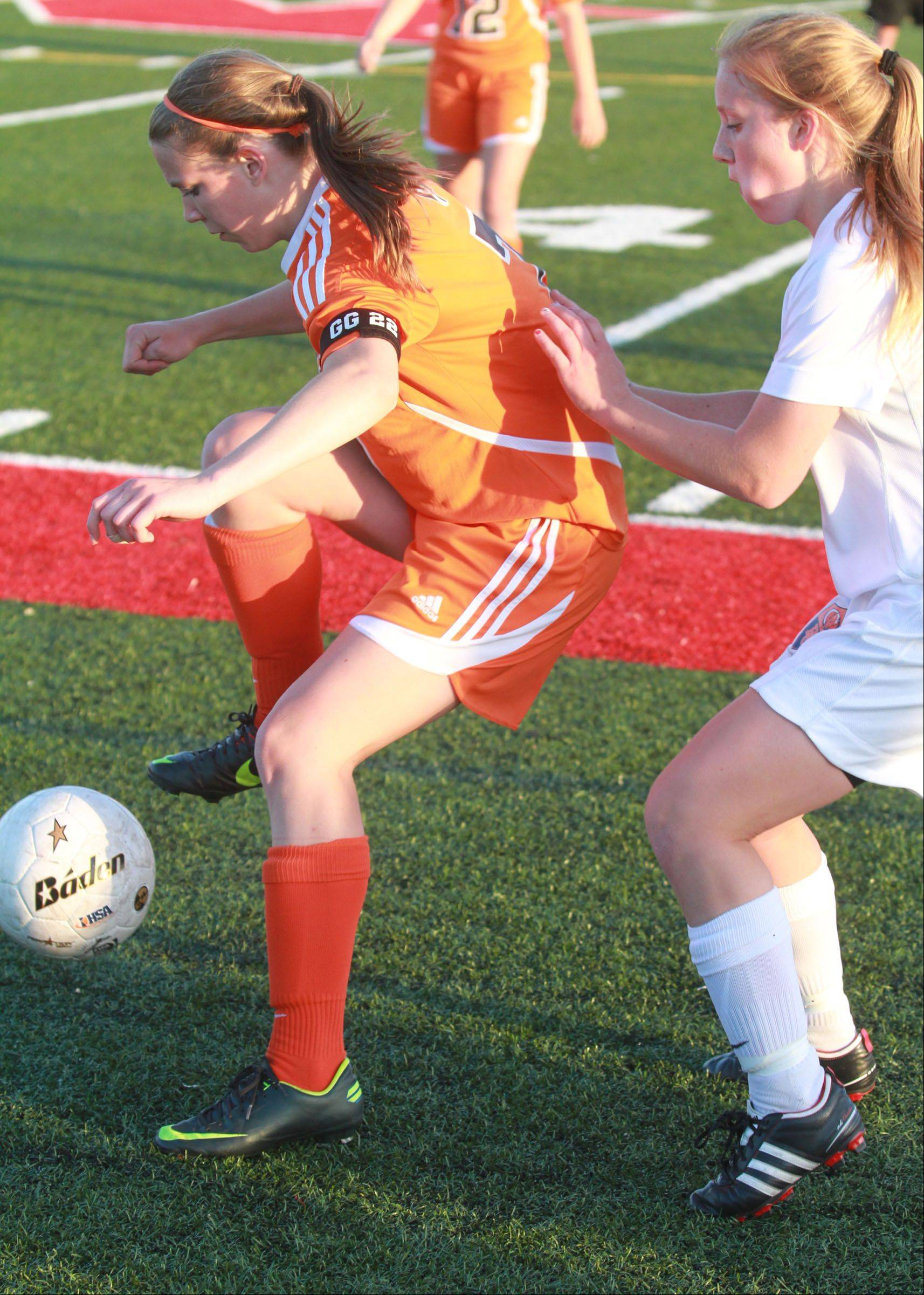 Hersey's Jessica Schmidt stops the ball to pass against Buffalo Grove defender Colleen Zickert as Buffalo Grove wins the Class 3A Mundelein girls soccer sectional final on Friday.