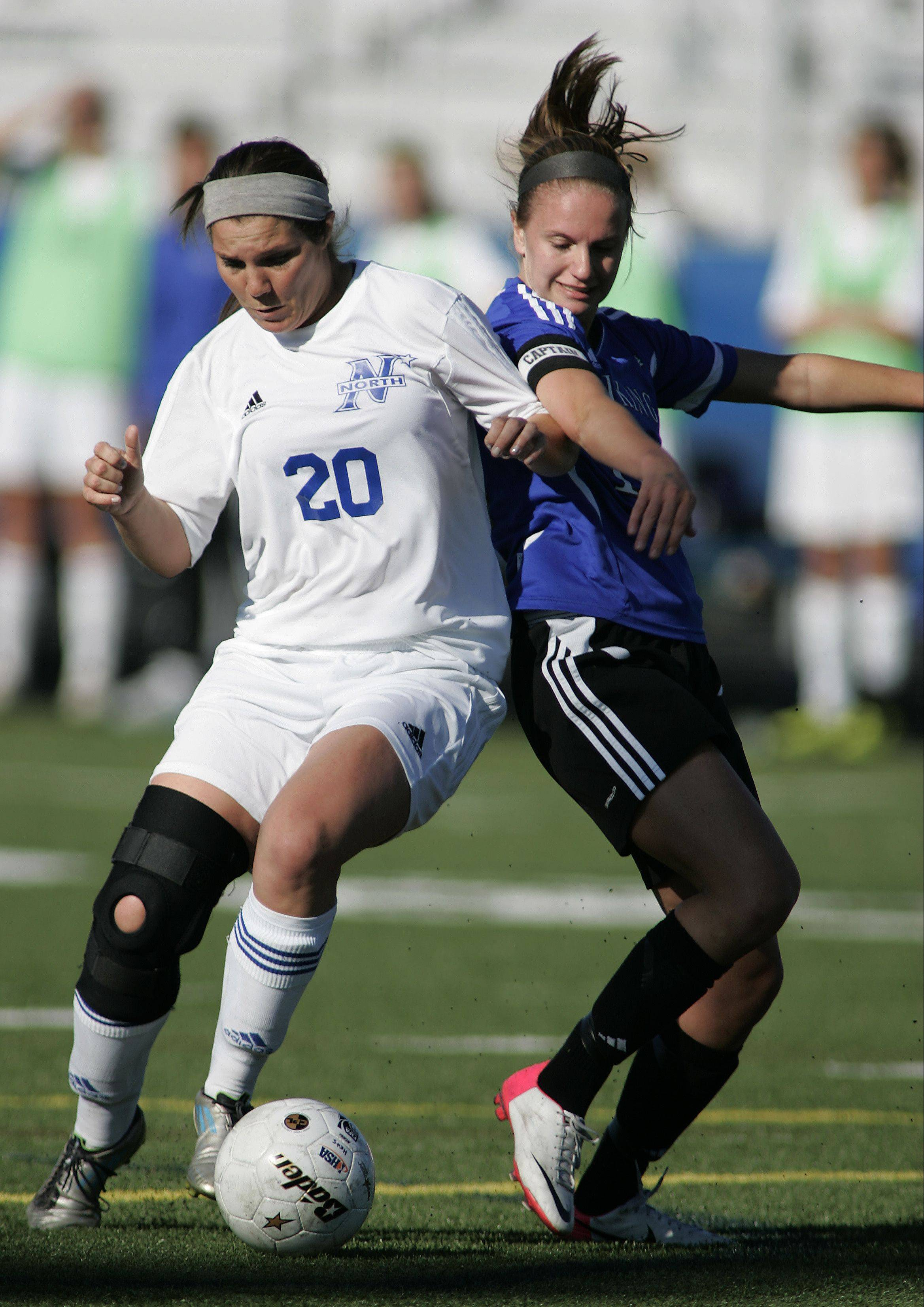 St. Charles North's Kenzie Rose (20) battles Geneva forward Amanda Lulek (10) for control of the ball Friday.