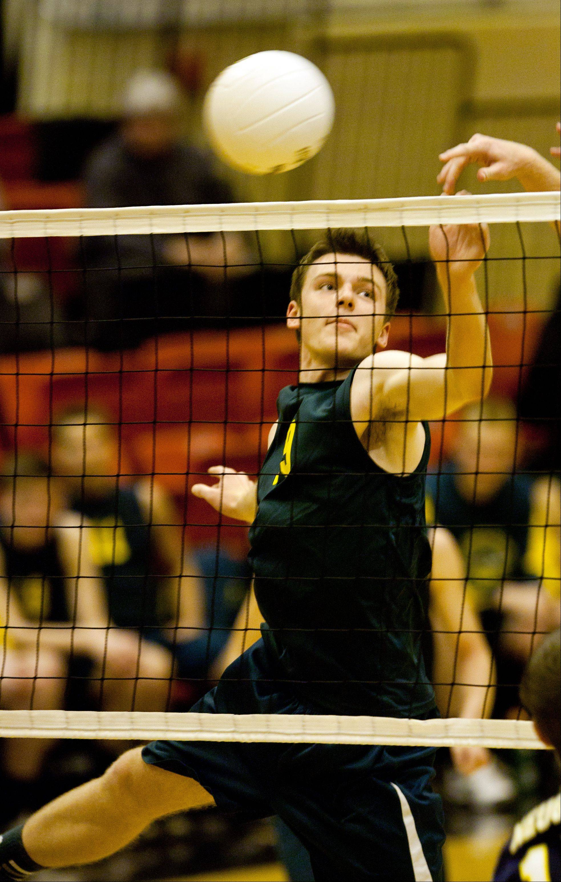 Waubonsie Valley's Tyler House returns a volley during the Proviso West boys volleyball sectional semifinal loss to Neuqua Valley..