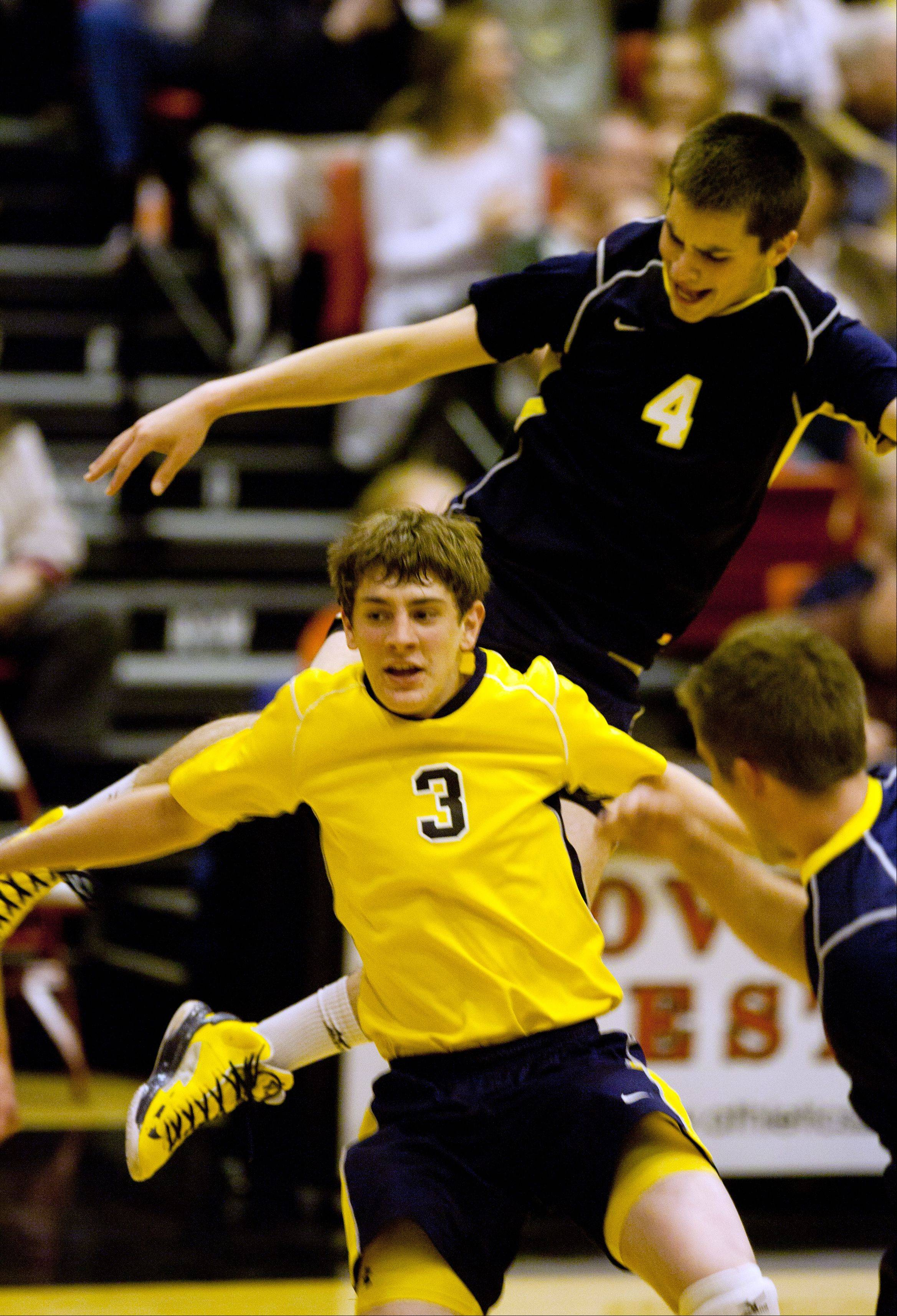 Neuqua Valley's Matthew Porter (3) and Jeremy Royko (4) celebrate a win over Waubonsie Valley, during the Proviso West boys volleyball sectional semifinals.