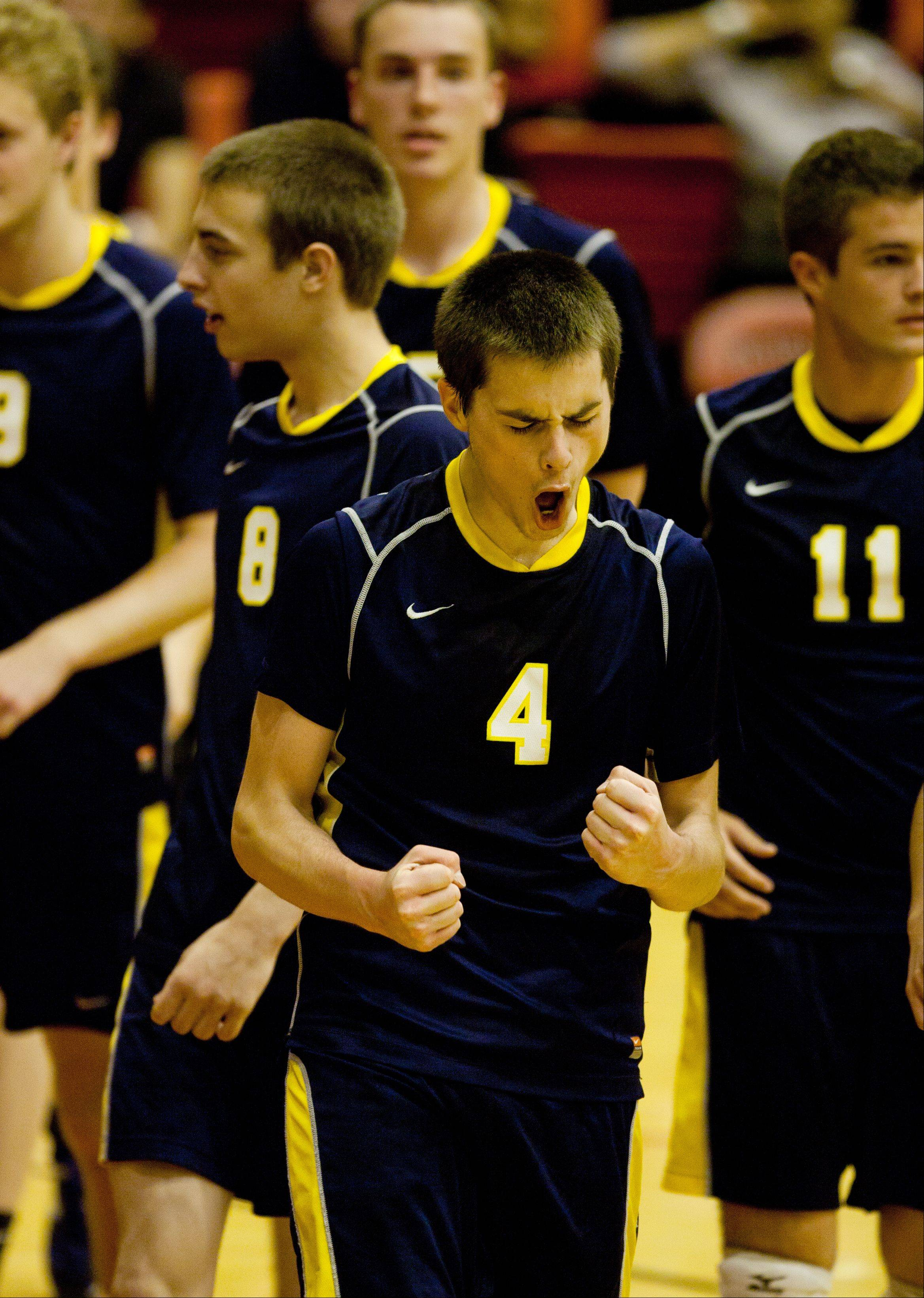 Neuqua Valley's Jeremy Royko (4) celebrates a win over Waubonsie Valley, during the Proviso West boys volleyball sectional semifinals.