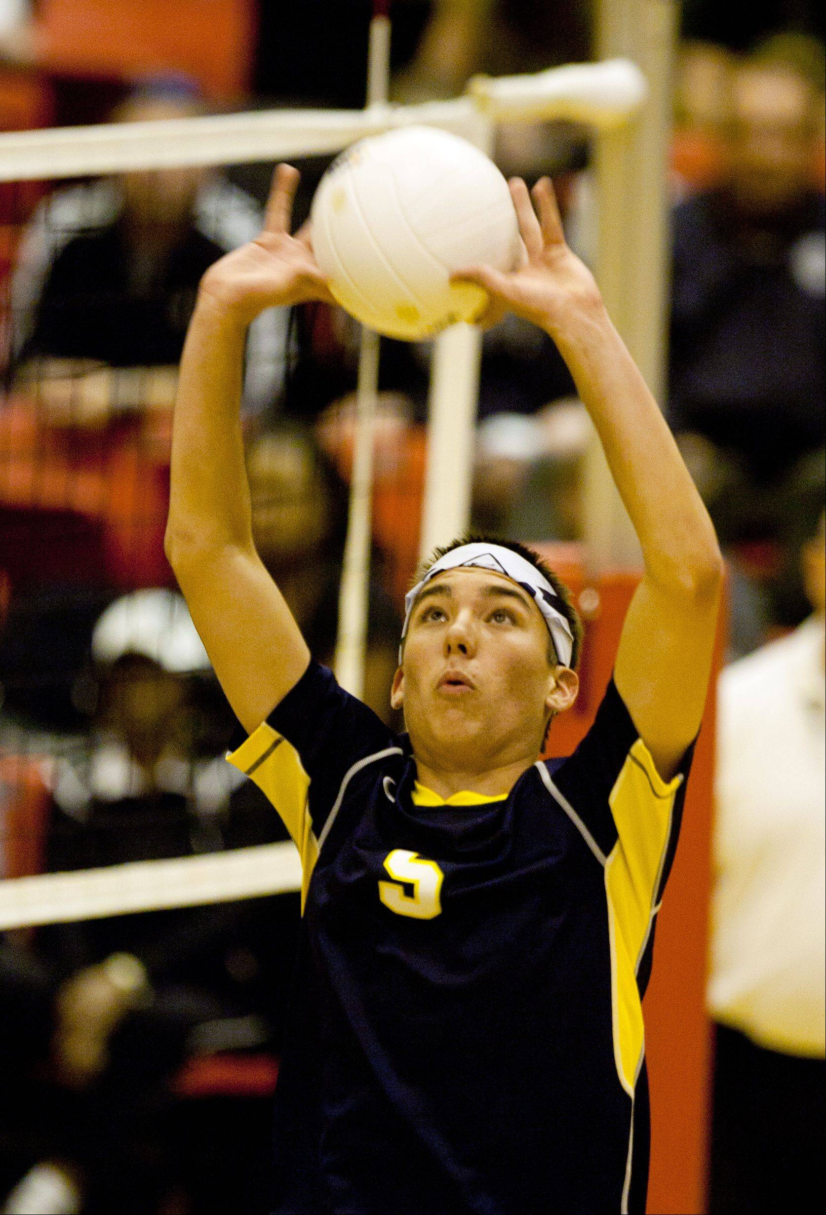 Neuqua Valley's Alex Coyne (5) sets the ball against Waubonsie Valley during the Proviso West boys volleyball sectional semifinal games.