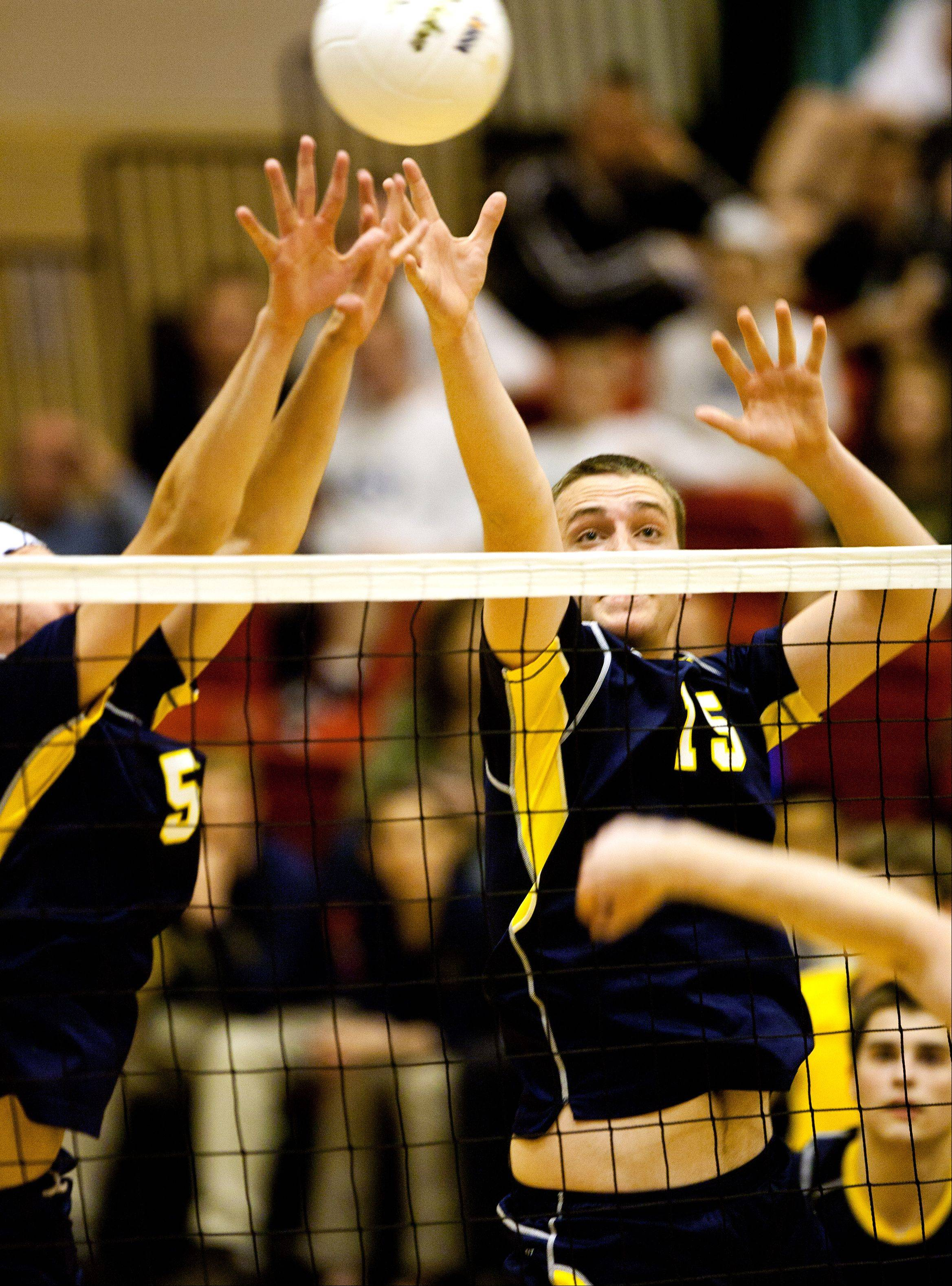 Neuqua Valley's Alex Coyne (5) and James Marton (15) battle Waubonsie Valley during the Proviso West boys volleyball sectional semifinals.