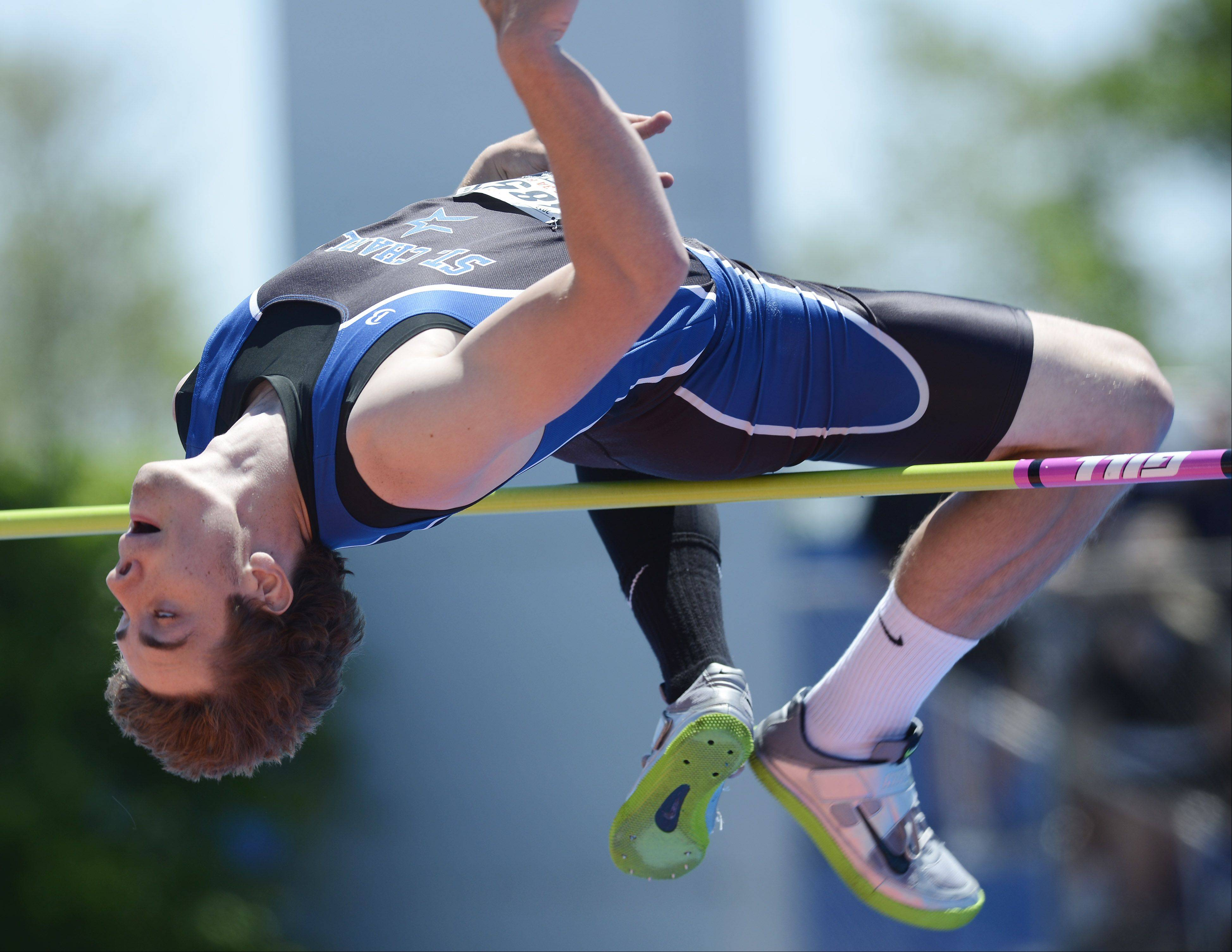 Erik Miller of St. Charles North clears the bar in the Class 3A high jump during the boys track state meet preliminaries in Charleston on Friday.
