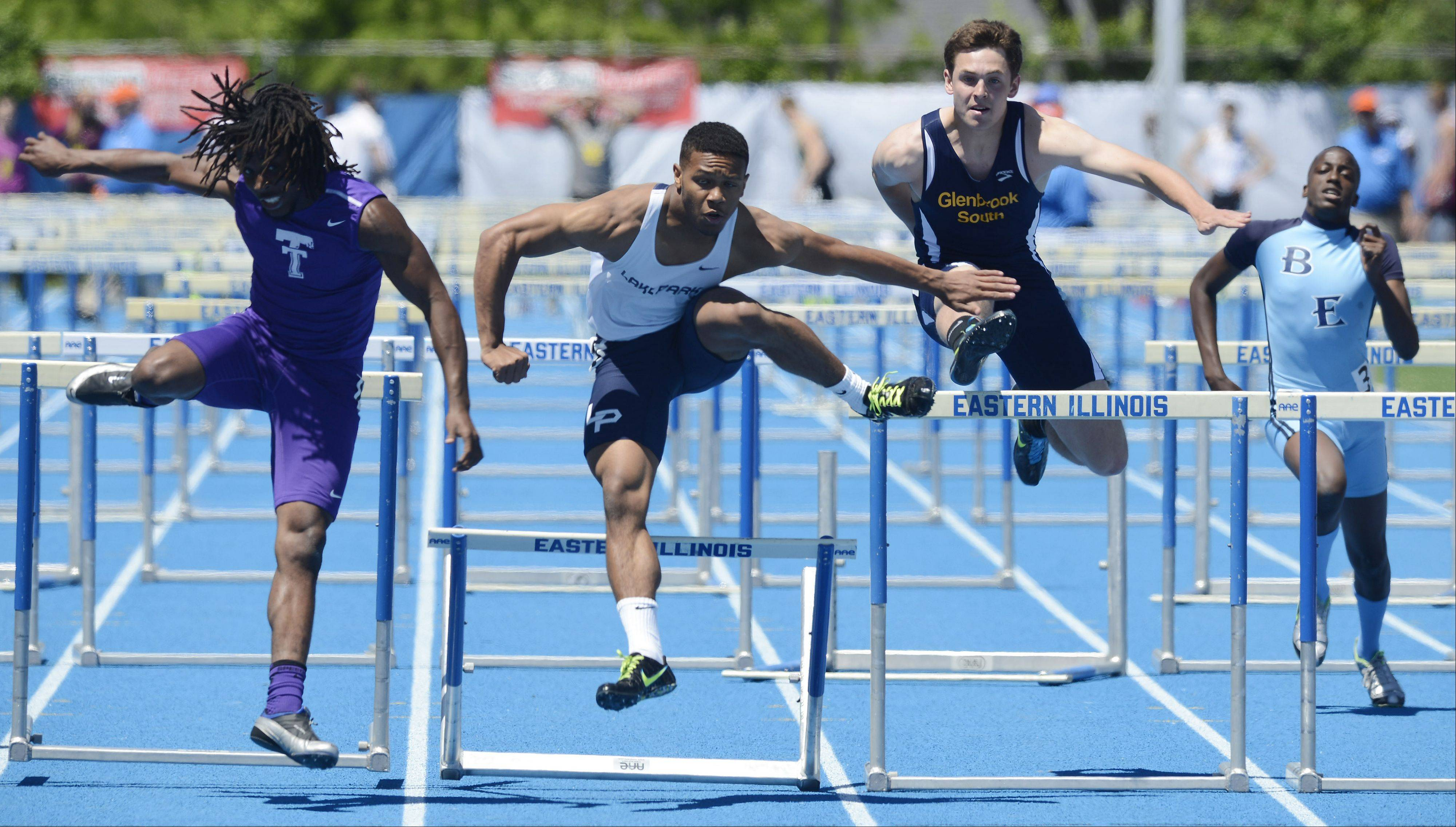 Antonio Shenault of Lake Park, second from left, clears the final hurdle in the Class 3A 110-meter high hurdles during the boys state track preliminaries in Charleston Friday.