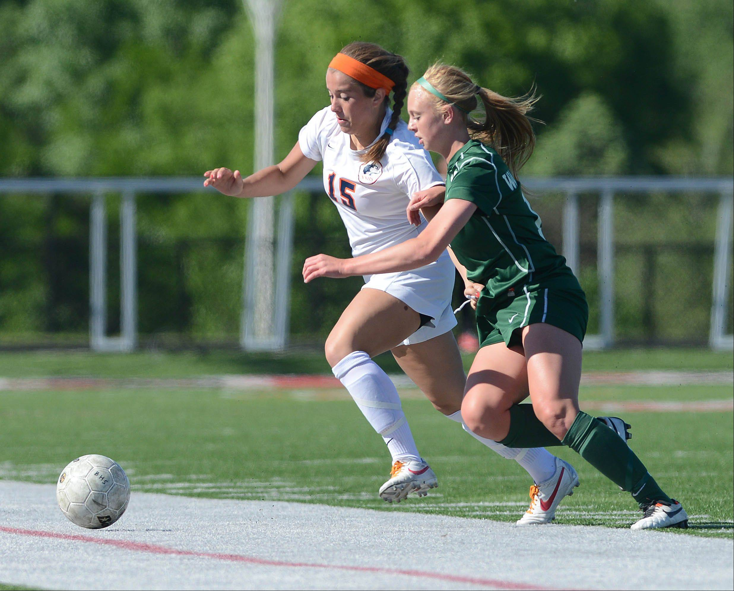 Cora Climo of Naperville North,left, and Sarah Laws of Waubonsie Valley move the ball during the Class 3A Bolingbrook girls soccer sectional final Friday.