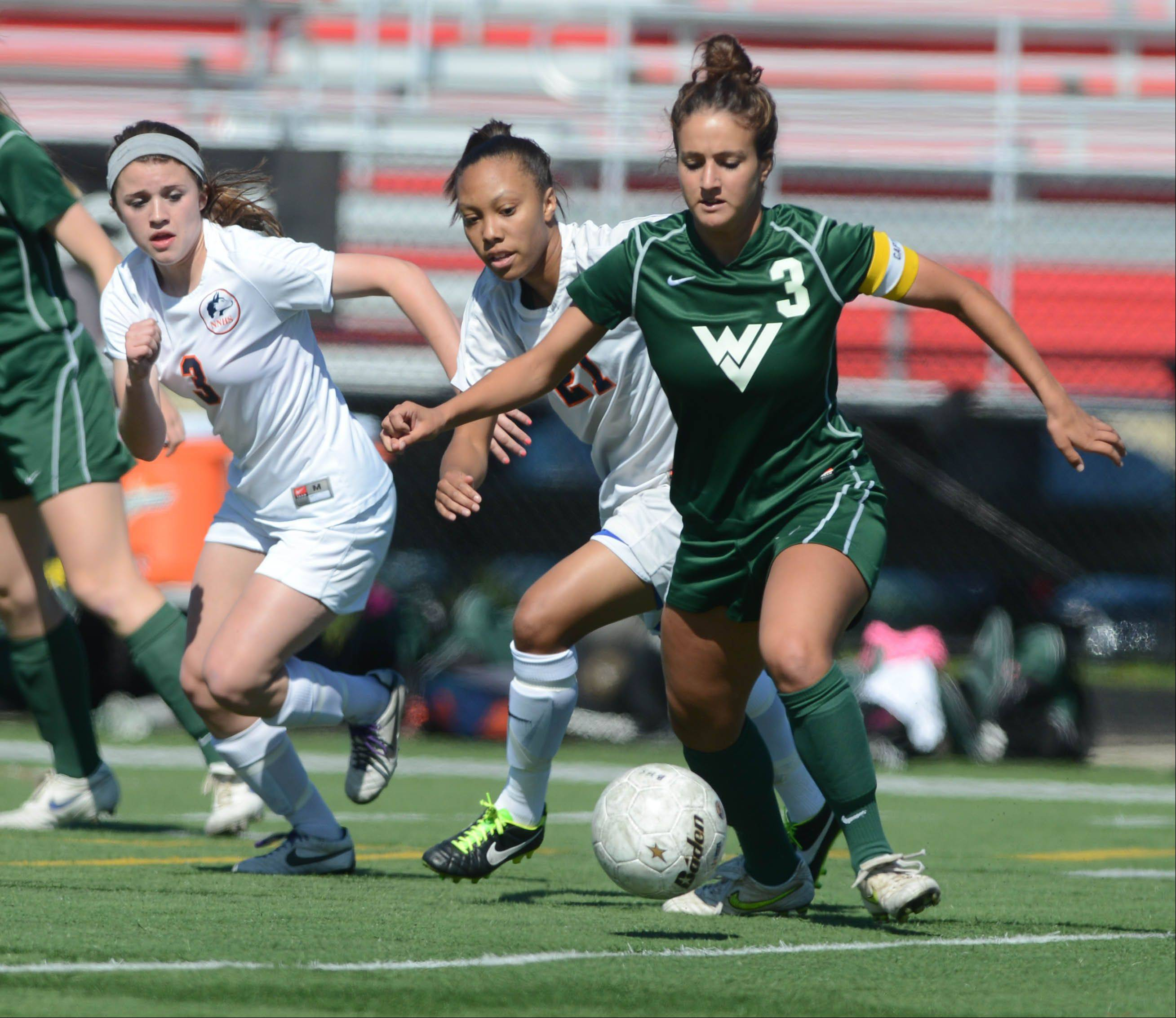 Jenna Romano of Waubonsie moves the ball while Claire Hilburger,left, and Zoe Swift of Naperville North follow. This took place during the Class 3A Bolingbrook girls soccer sectional final.
