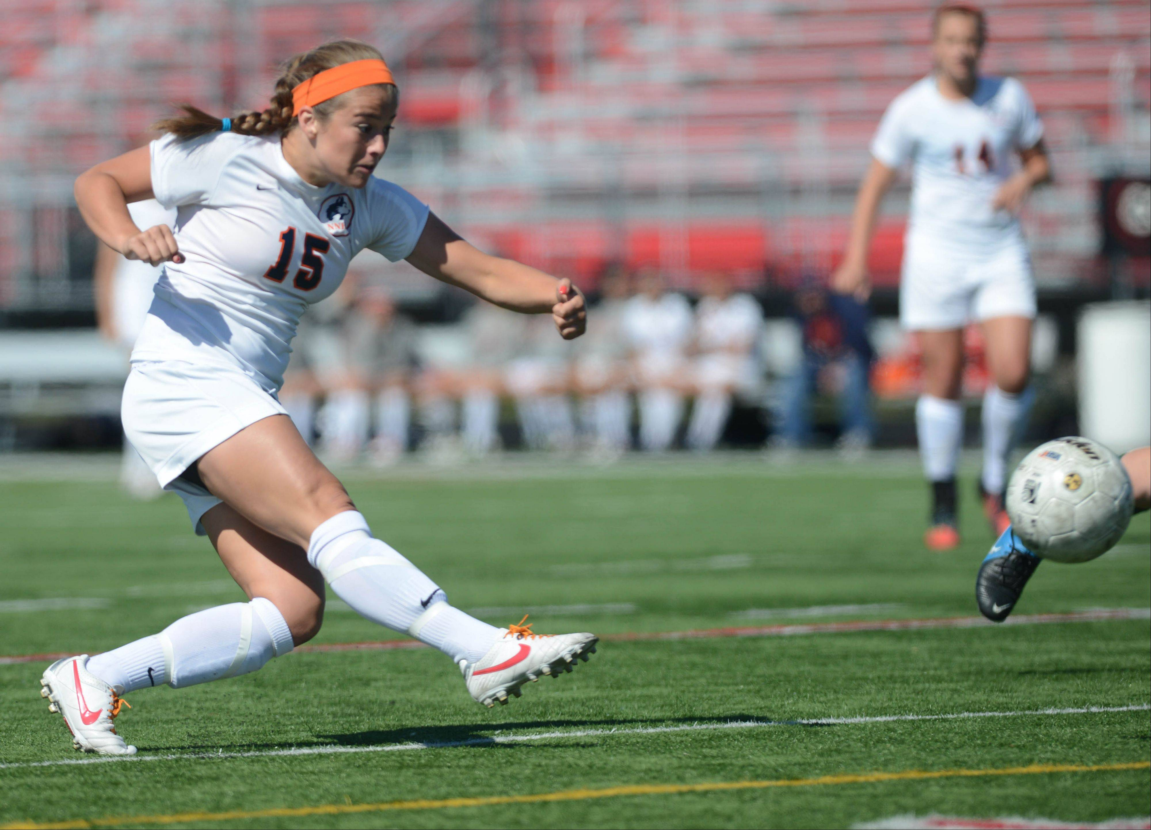 Cora Climo of Naperville North takes a shot during the Class 3A Bolingbrook girls soccer sectional final Friday.