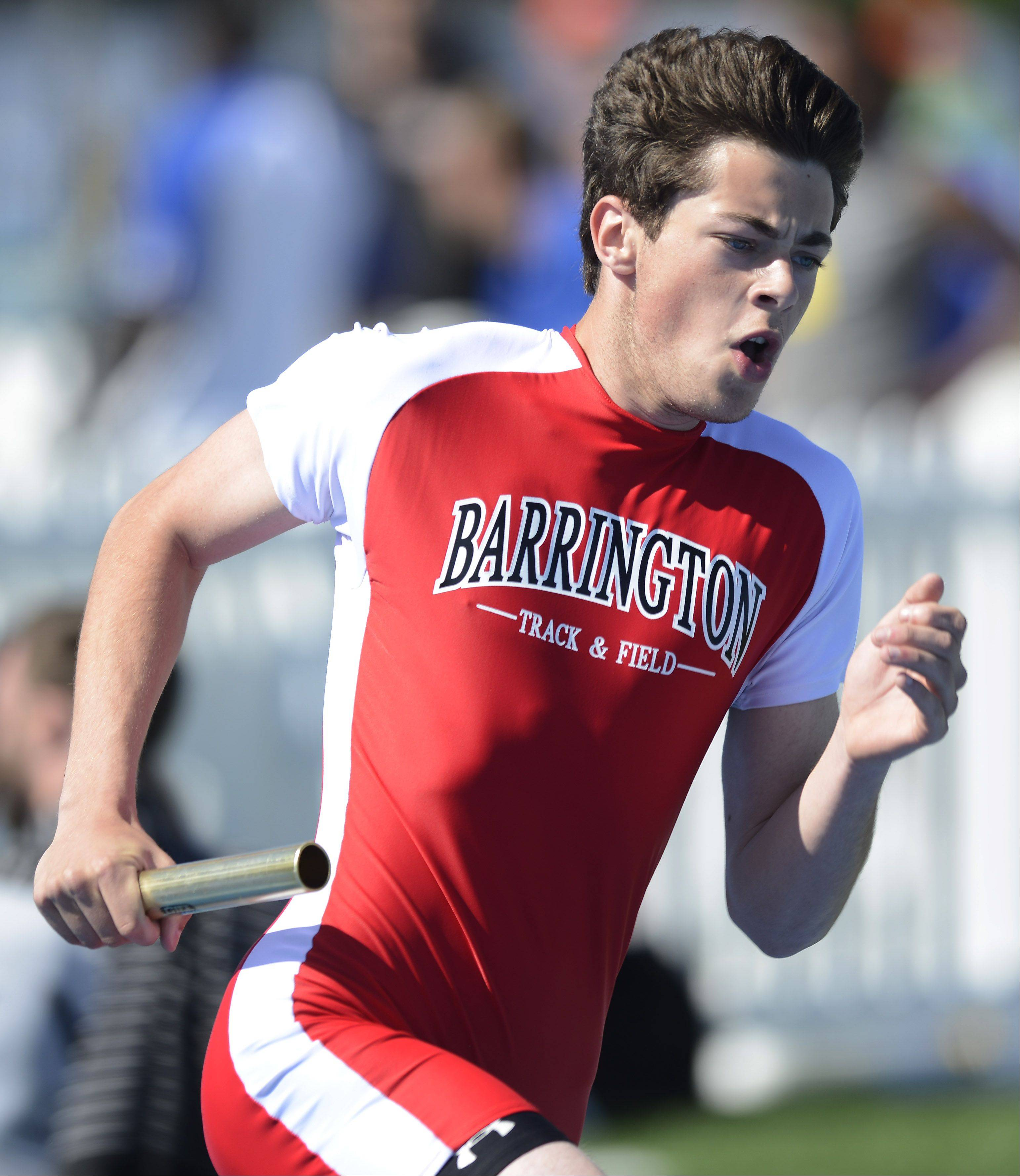 Barrington's John Andraschko carries the baton for his team in the Class 3A 4x400-meter relay during the boys track state meet preliminaries in Charleston on Friday.